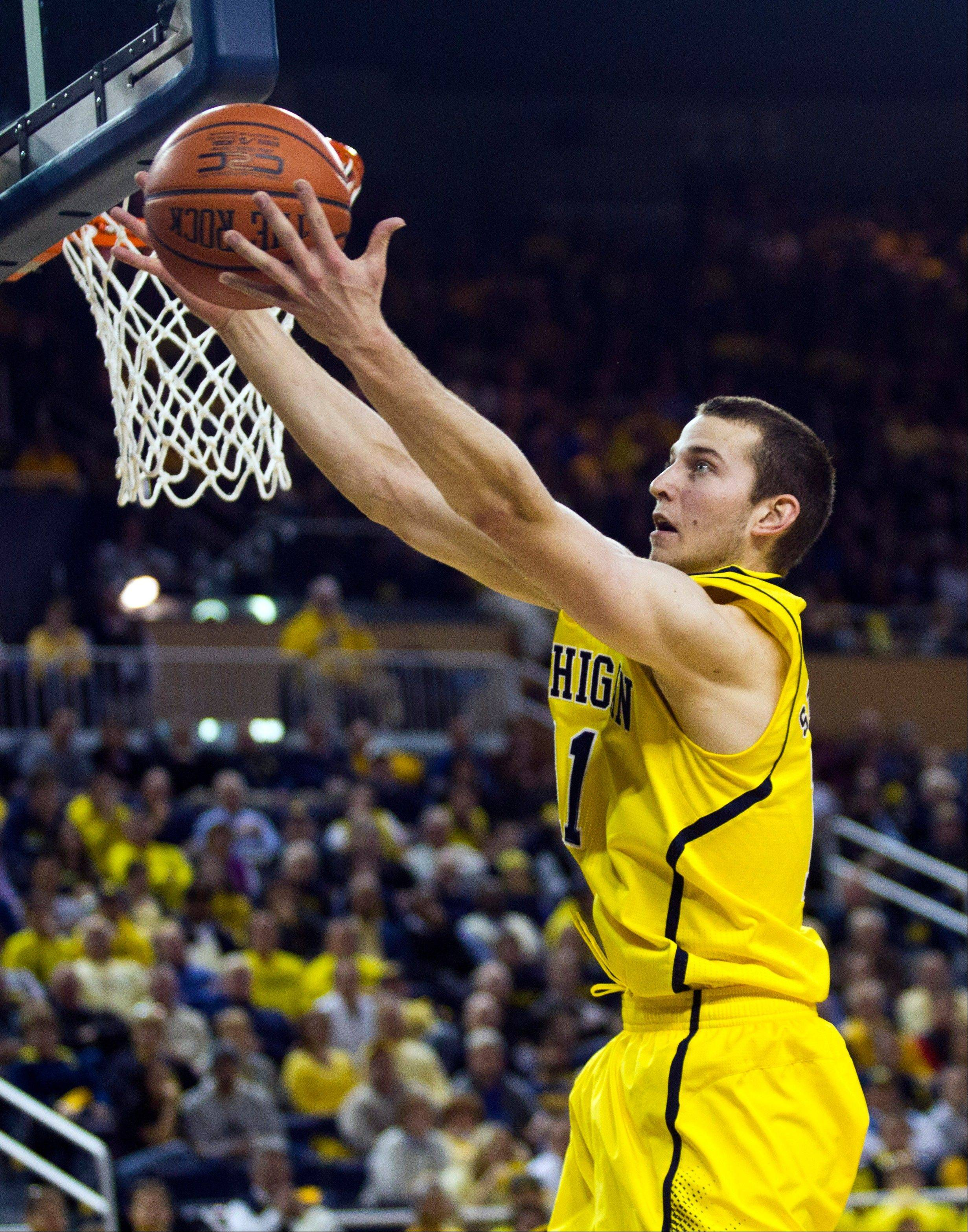 Michigan guard Nik Stauskas grabs a defensive rebound Tuesday during the first half against North Carolina State, Tuesday in Ann Arbor, Mich.