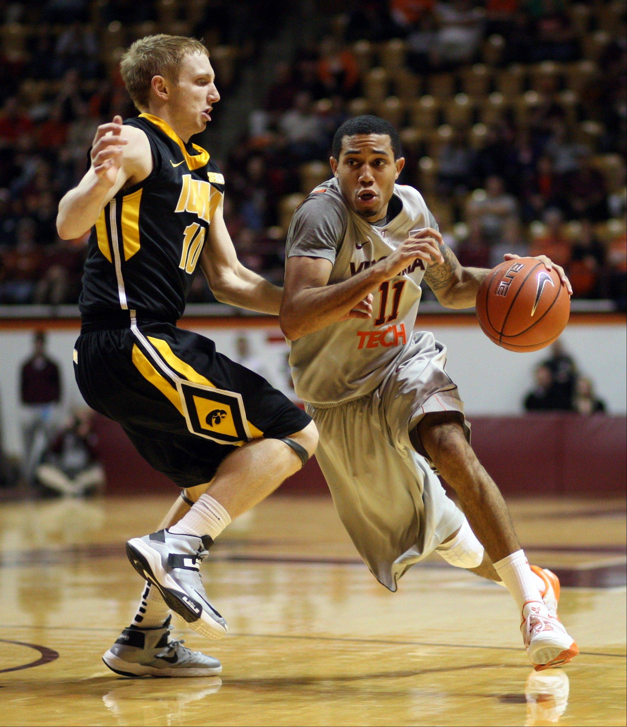 Virginia Tech's Erick Green goes around Iowa's Mike Gesell into the lane Tuesday in Blackburg, Va.