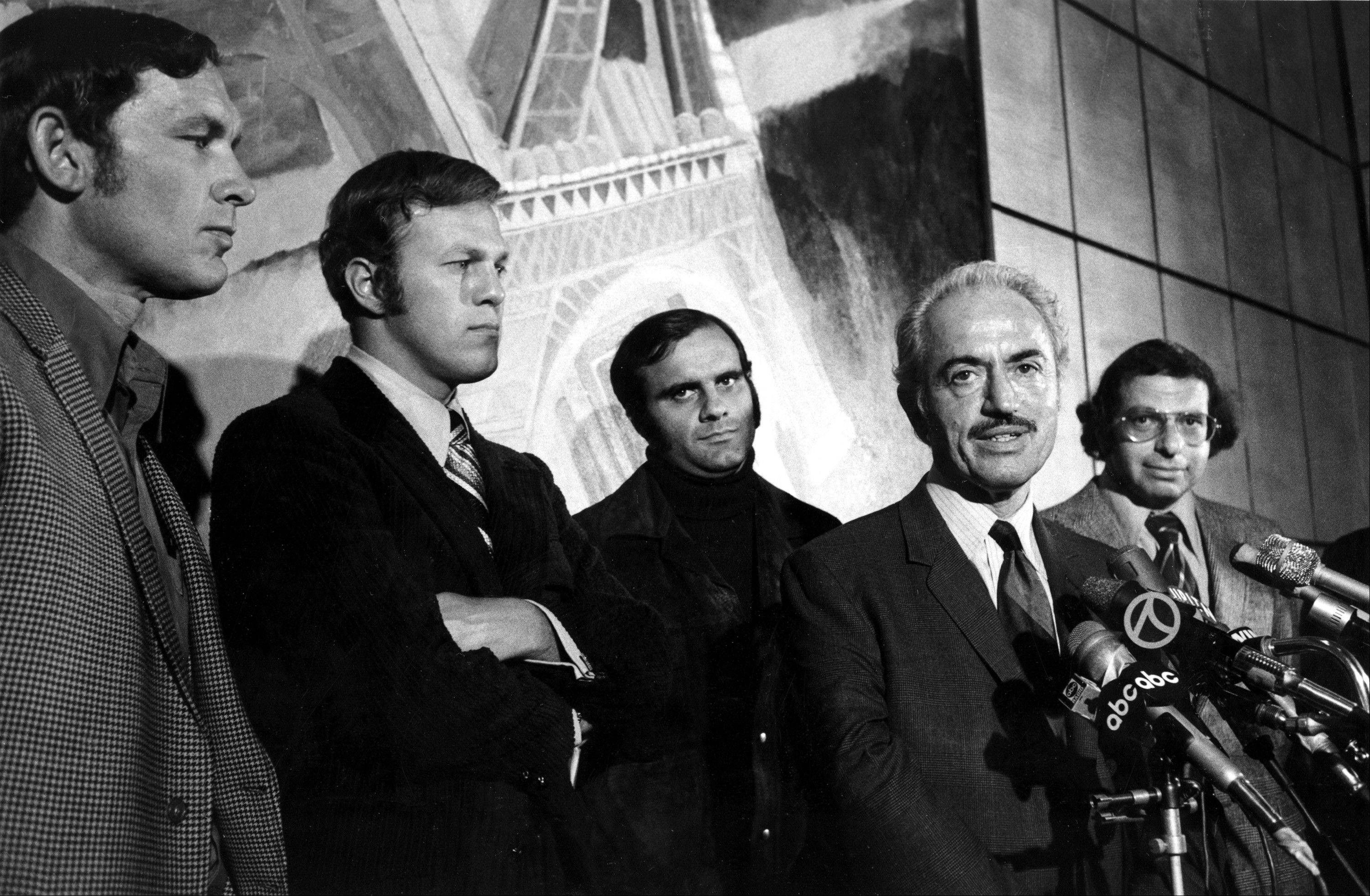 This April 13, 1972 file photo shows Marvin Miller, executive director of the Major League Baseball Players Association, announcing an end to the baseball strike at a news conference in New York. Players shown are, from left, Gary PeTers of the Boston Red Sox, Wes Parker of the Los Angeles Dodgers, and Joe Torre of the St. Louis Cardinals. At right is Dick Moss, general counsel for the association. Miller, the union leader who created free agency for baseball players and revolutionized professional sports with multimillion dollar contracts, died Tuesday, Nov. 27, 2012 in New York. He was 95.