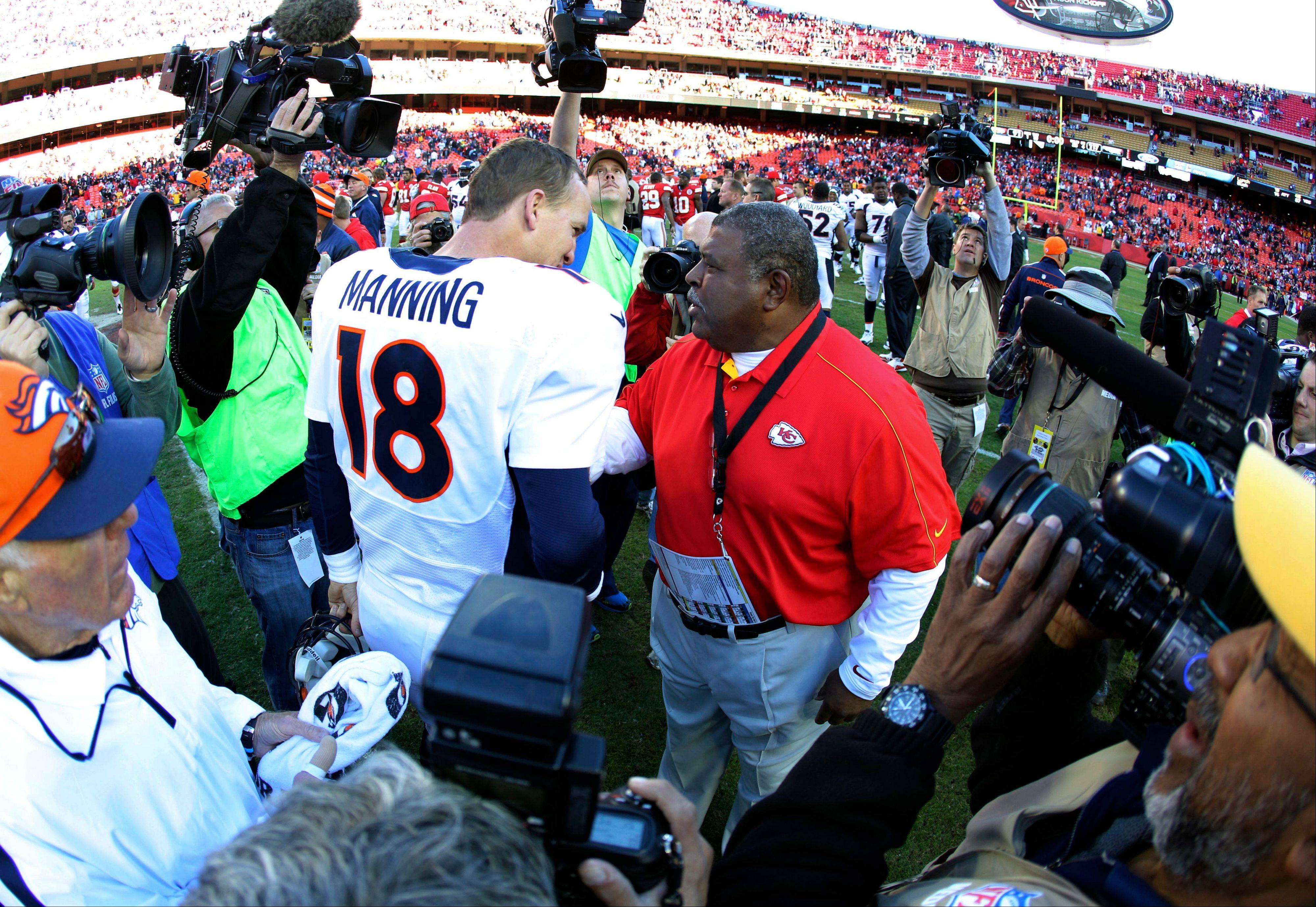 Denver Broncos quarterback Peyton Manning talks Sunday with Kansas City Chiefs coach Romeo Crennel following the Broncos 17-9 win Sunday.