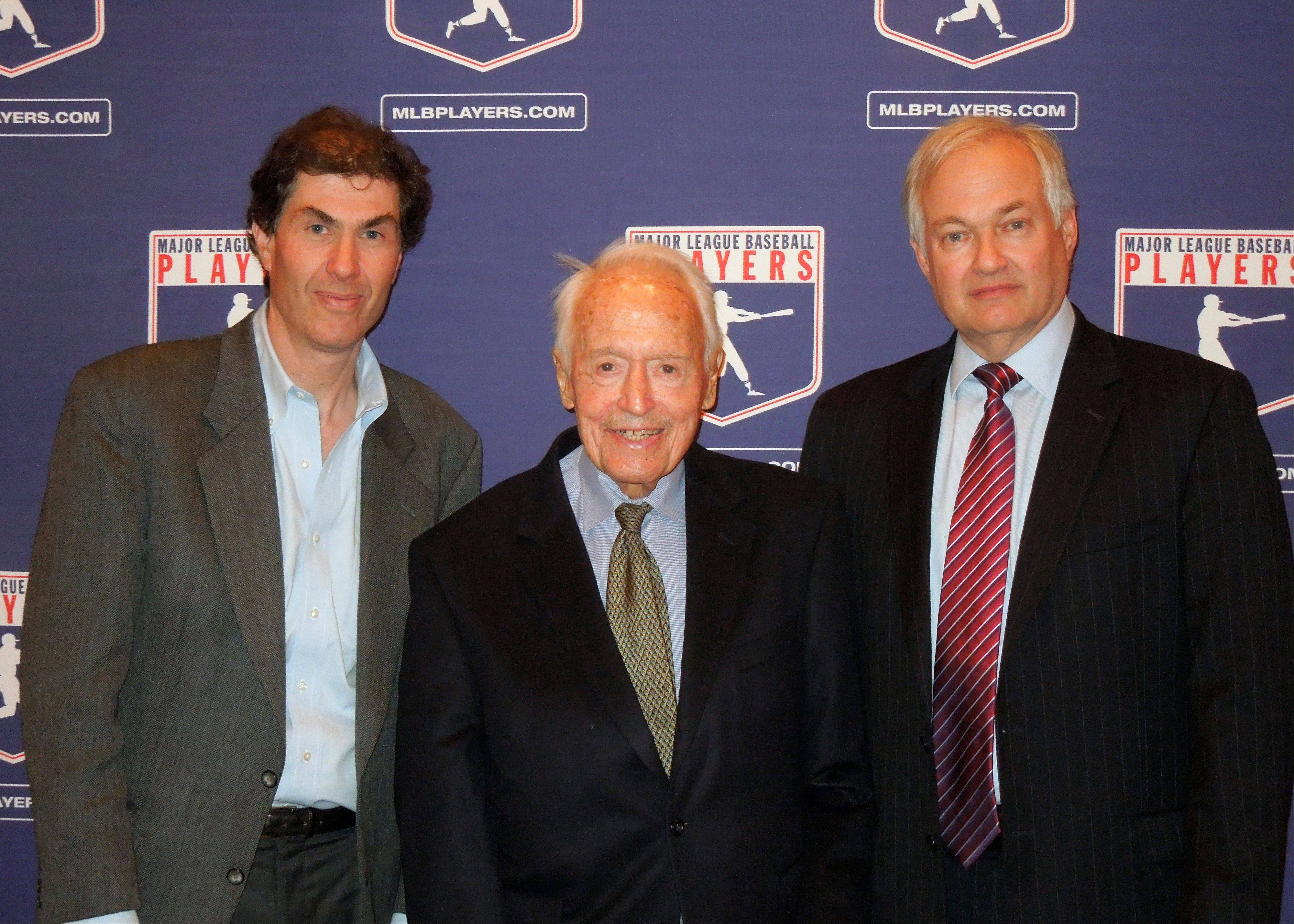 In this April 24, 2012 photo provided by the Major League Baseball Players Association, Michael Weiner, left, MLBPA executive director; Marvin Miller, center, former head of the association; and Donald Fehr, former MLBPA executive director and currently the executive director of the NHL Players' Association, gather for a photo at New York University School of Law in New York, where Miller discussed the 40th anniversary of the first baseball strike. Miller, the union leader who created free agency for baseball players and revolutionized professional sports with multimillion dollar contracts, died Tuesday. He was 95.