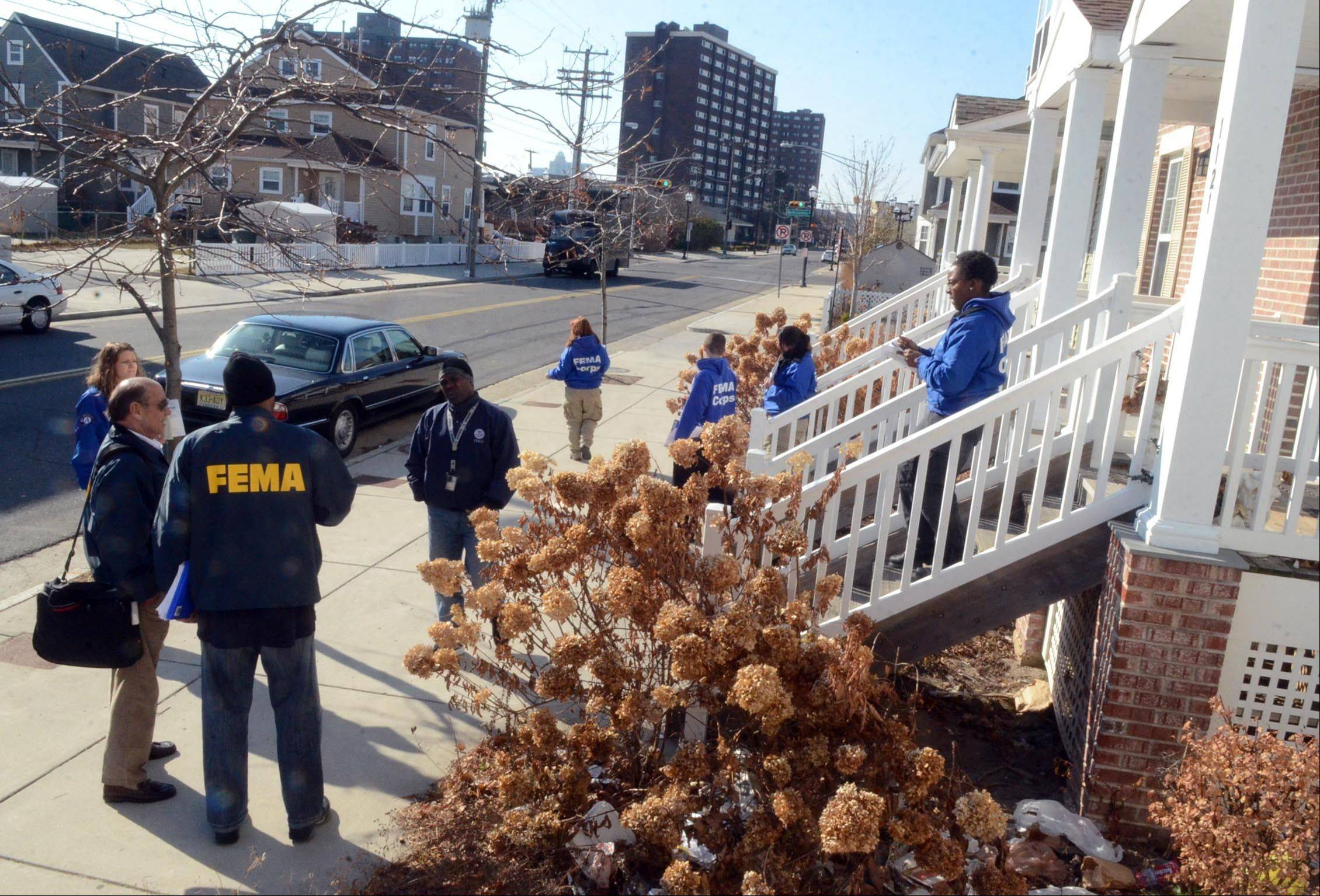 FEMA workers and FEMA Corps volunteers canvas the Mid Town section of Atlantic City, N.J., talking with residents or leaving information in their doorway this week.