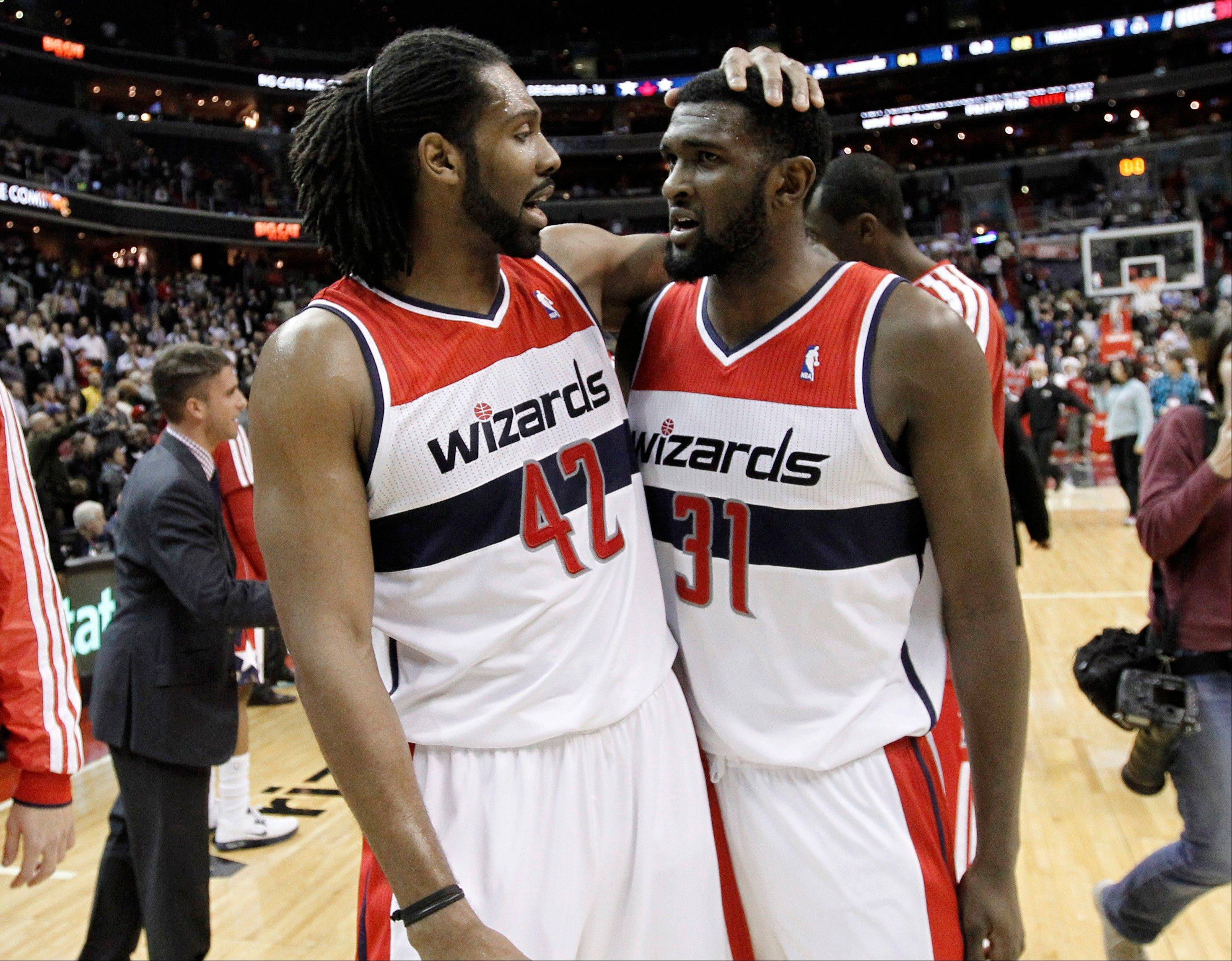 Washington Wizards center Nene, left, and forward Chris Singleton celebrate Wednesday in the closing moments against the Portland Trail Blazers in Washington. The Wizards won for the first time this season, beating the Trail Blazers 84-82.