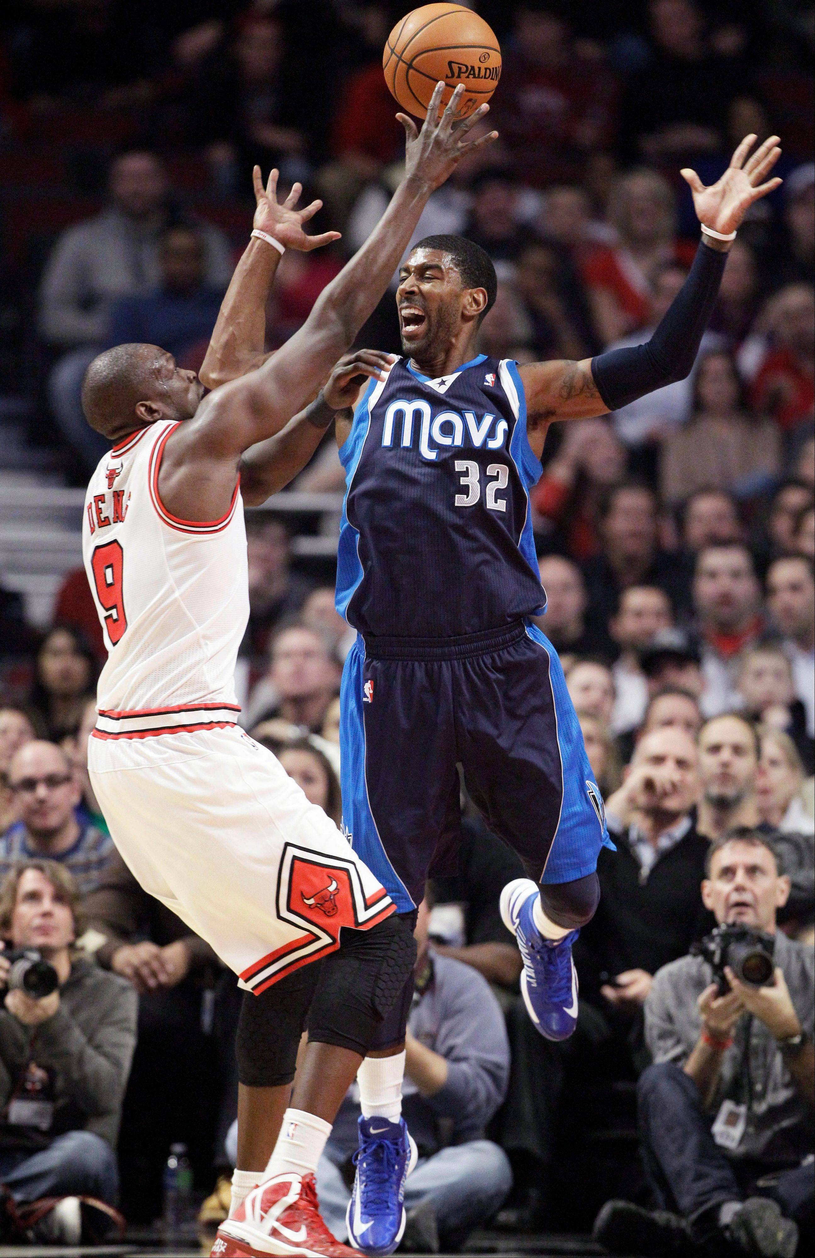 Bulls forward Luol Deng blocks a pass by Dallas Mavericks guard O.J. Mayo Wednesday during the first half at the United Center.