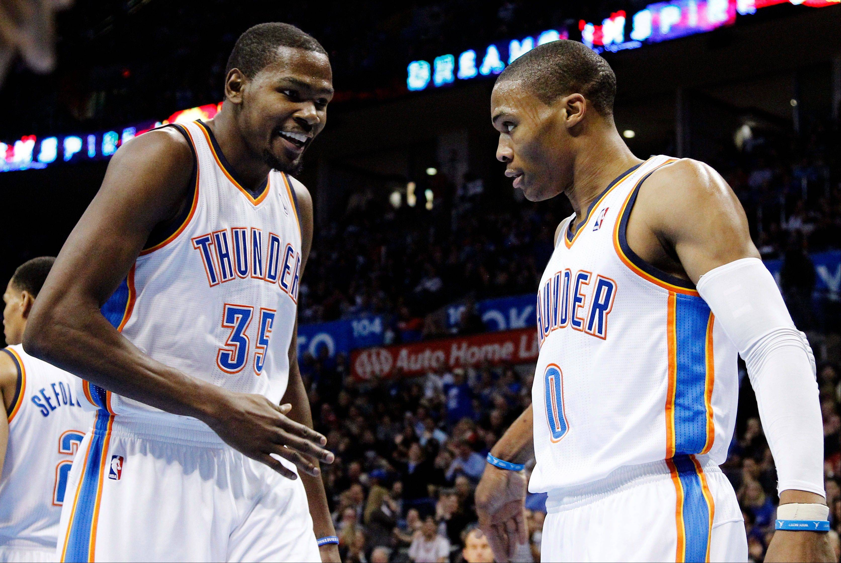 Oklahoma City Thunder forward Kevin Durant (35) and guard Russell Westbrook (0) react Wednesday after Westbrook blocked a shot by Houston Rockets guard James Harden during the first quarter in Oklahoma City.