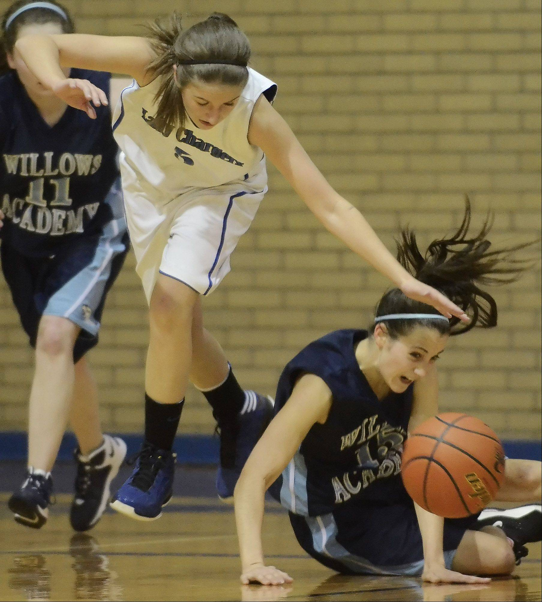 Christian Liberty Academy�s Jess Moriarty, left, tries to take control of a loose ball as Keelin McNally of Willows Academy falls to the floor during Wednesday�s game.