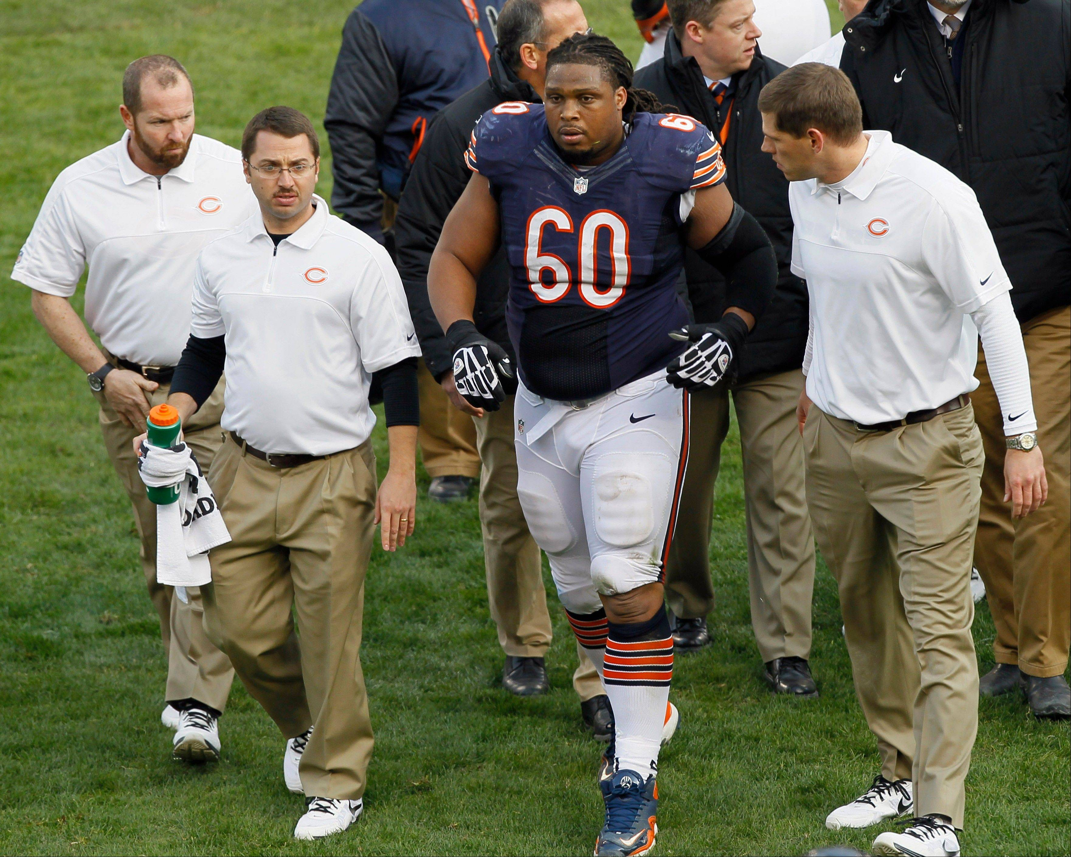 Bears guard Lance Louis (60) is helped from the field by trainers after he injured his knee from a block by Minnesota�s Jared Allen. Louis is out for the year with a torn ACL, and Allen is expected to be finded $21,000 for the hit.