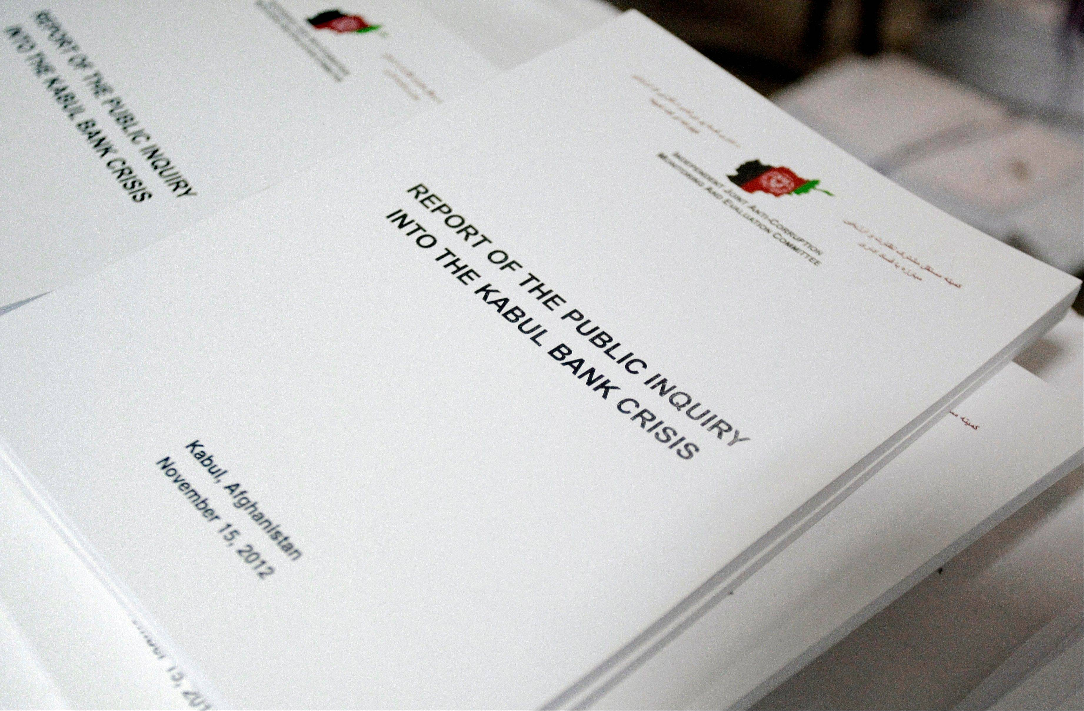 "Books containing the reports on Kabul Bank crisis are seen piled up to be distributed to media members during the release of the report in Kabul, Afghanistan, Wednesday, Nov. 28, 2012. The bank's failure and subsequent bailout represents more than 5 percent of Afghanistan's gross domestic product, making it ""one of the largest banking failures in the world,"" according to the report by the Independent Joint Anti-Corruption Monitoring and Evaluation Committee. The report said ""hundreds of millions"" were sent out of the impoverished nation where Afghan, U.S. and NATO forces are fighting an 11-year-old war with the Taliban and other militants."
