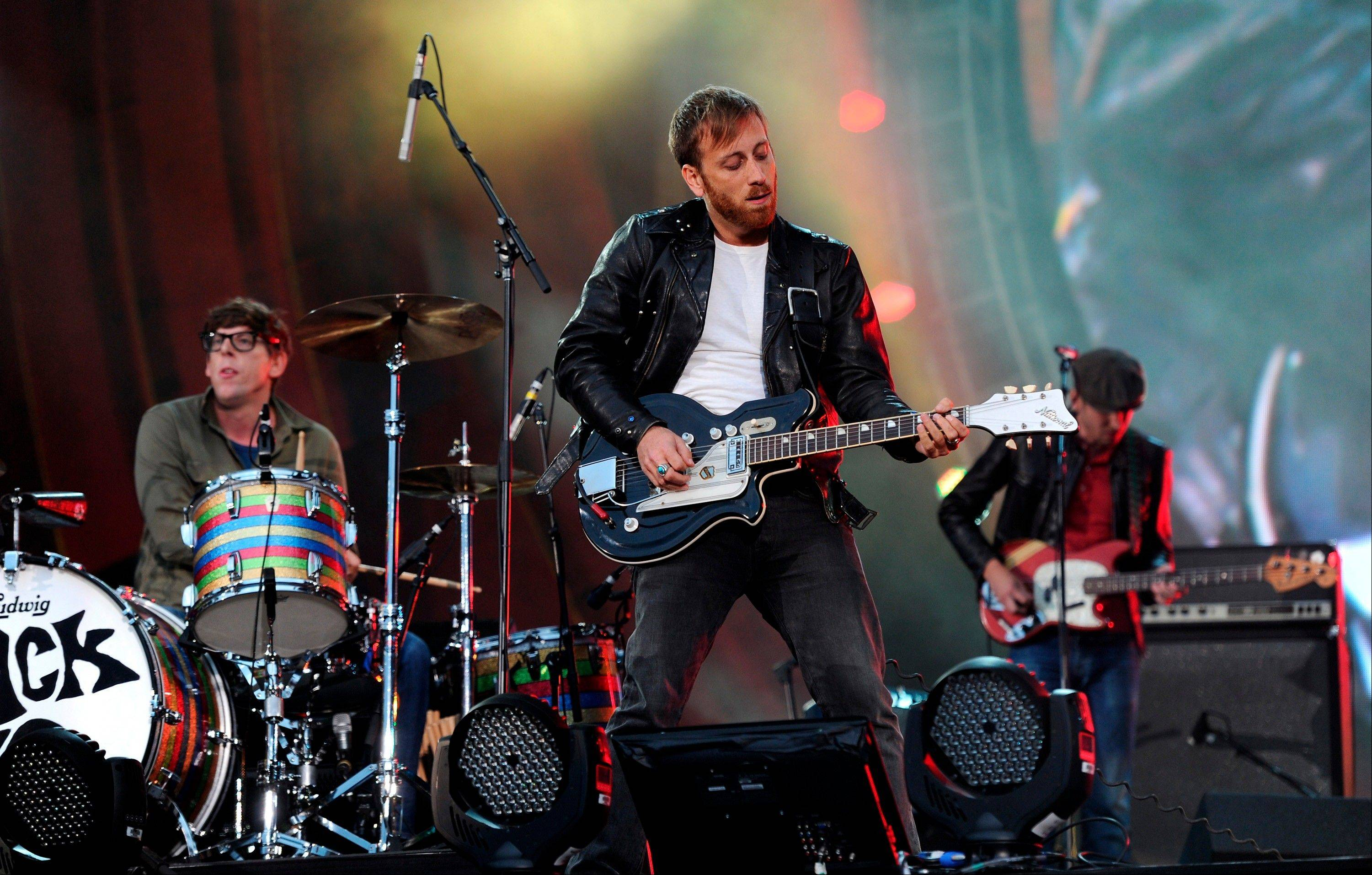Guitarist Dan Auerbach, center, and drummer Patrick Carney of The Black Keys perform at the Global Citizen Festival in Central Park, in New York.
