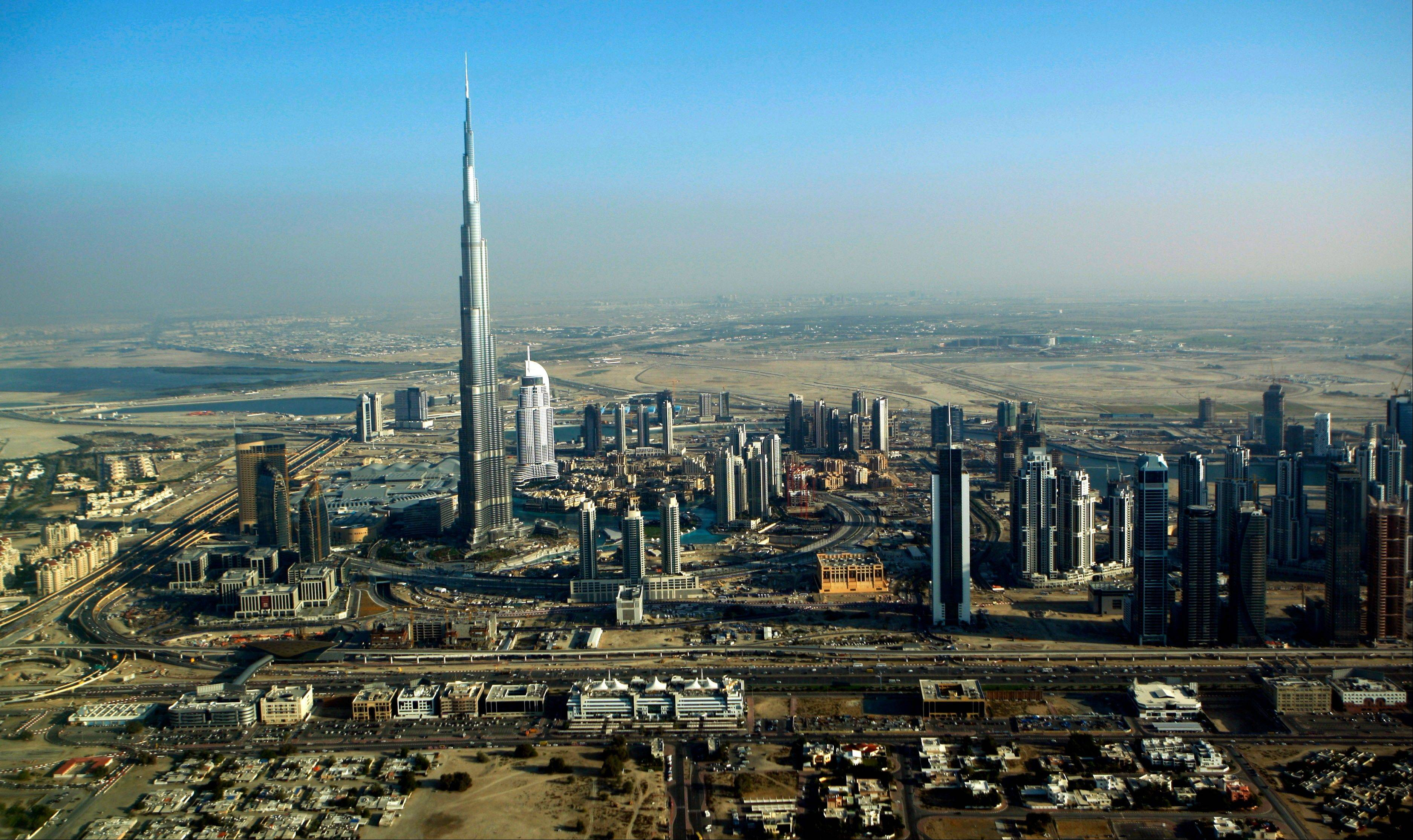 The Burj Dubai, the world's tallest building, in Dubai, United Arab Emirates. It suddenly seems like Dubai is rediscovering its old habits. That means breathless hype is now back in vogue. Construction plans are again peppered with superlatives.