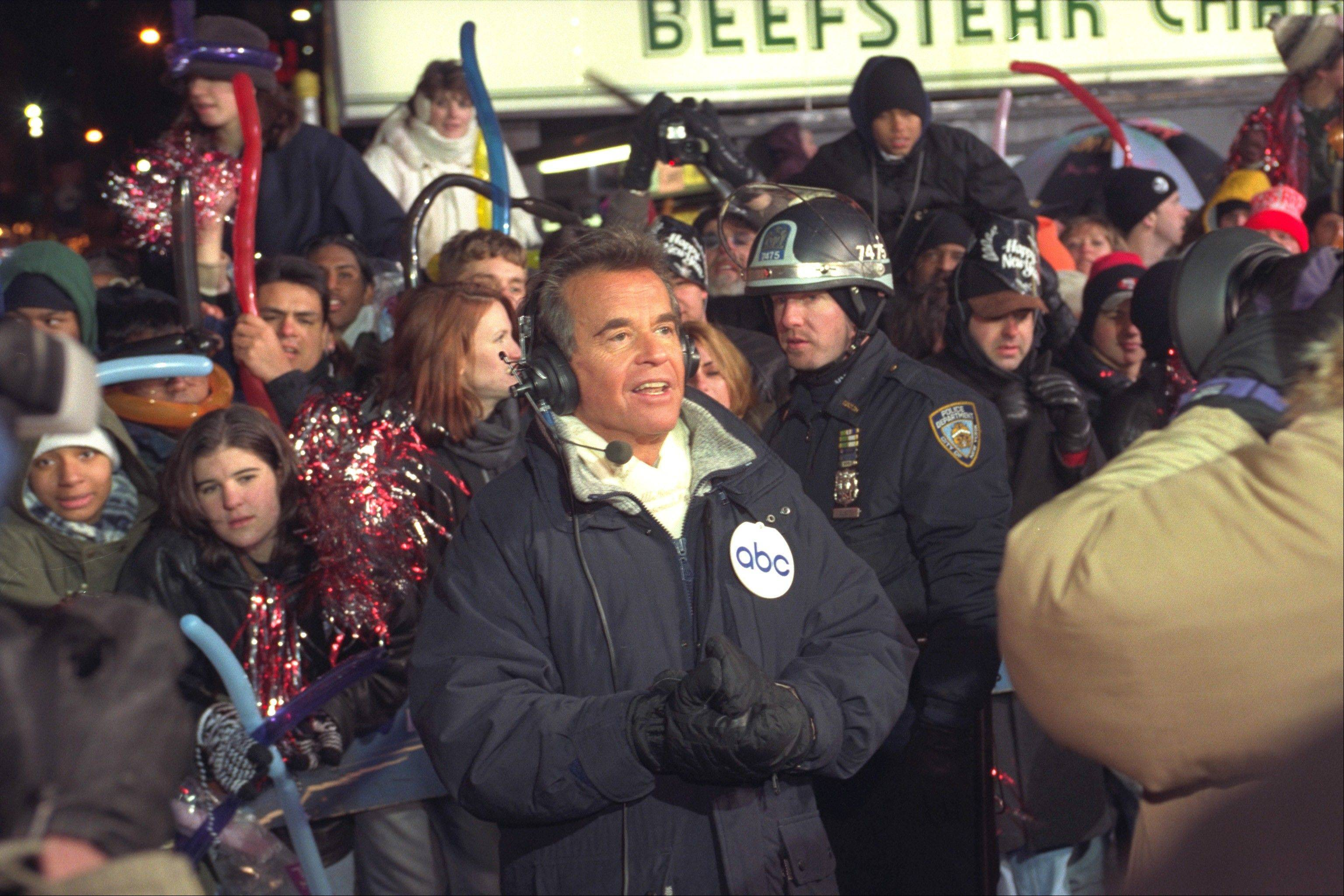 Dick Clark broadcasts during New Year's festivities from Times Square in New York in 1996. ABC is turning its first New Year's Eve without Dick Clark partly into a celebration of the show biz impresario's life.