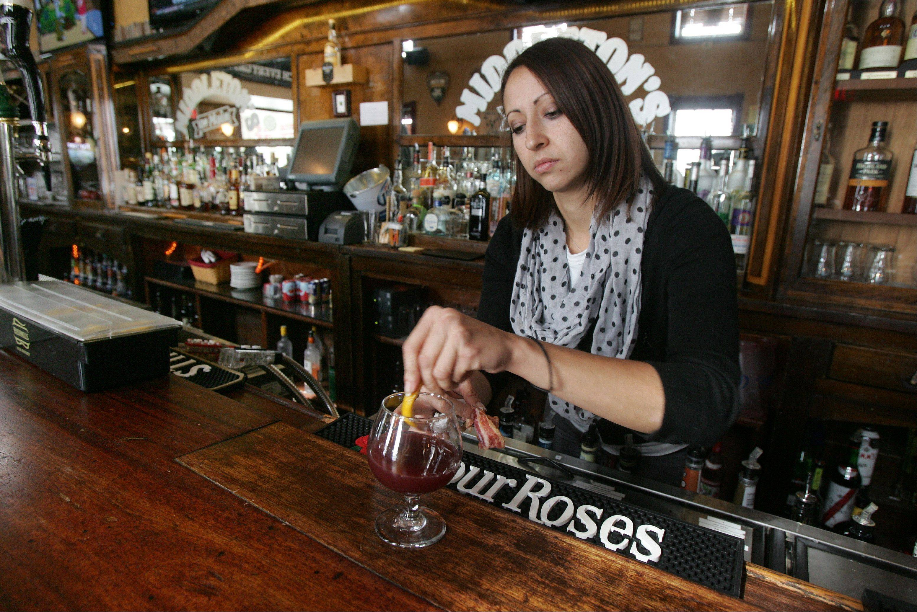 Bartender Jaime Goldstein makes a Bacon Cherry Creek Cocktail at Middleton's On Main restaurant in Wauconda.