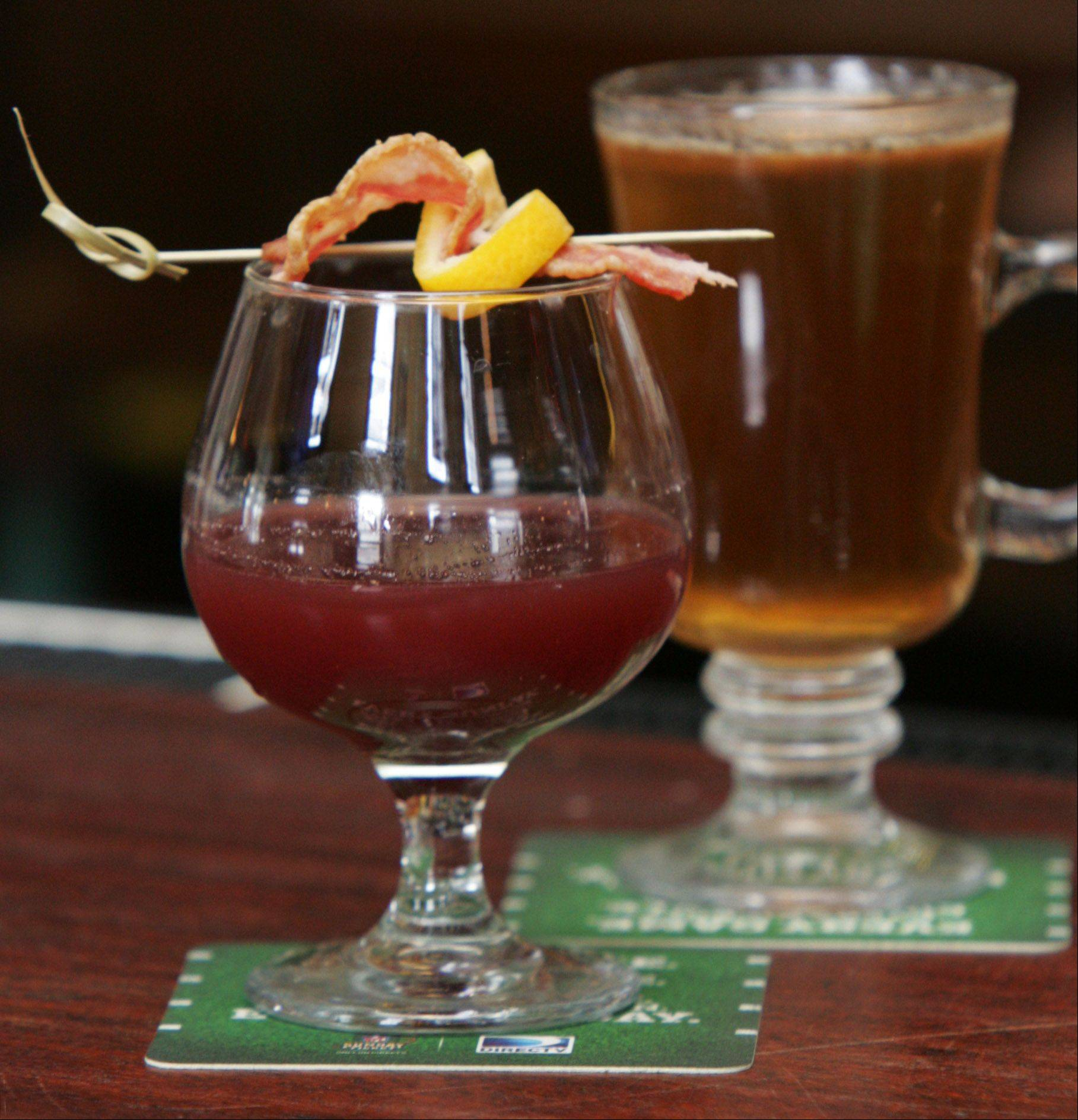 The Bacon Cherry Creek Cocktail, left, and Harvest Hot Buttered Rum are among the bar options at Middleton's On Main in Wauconda.