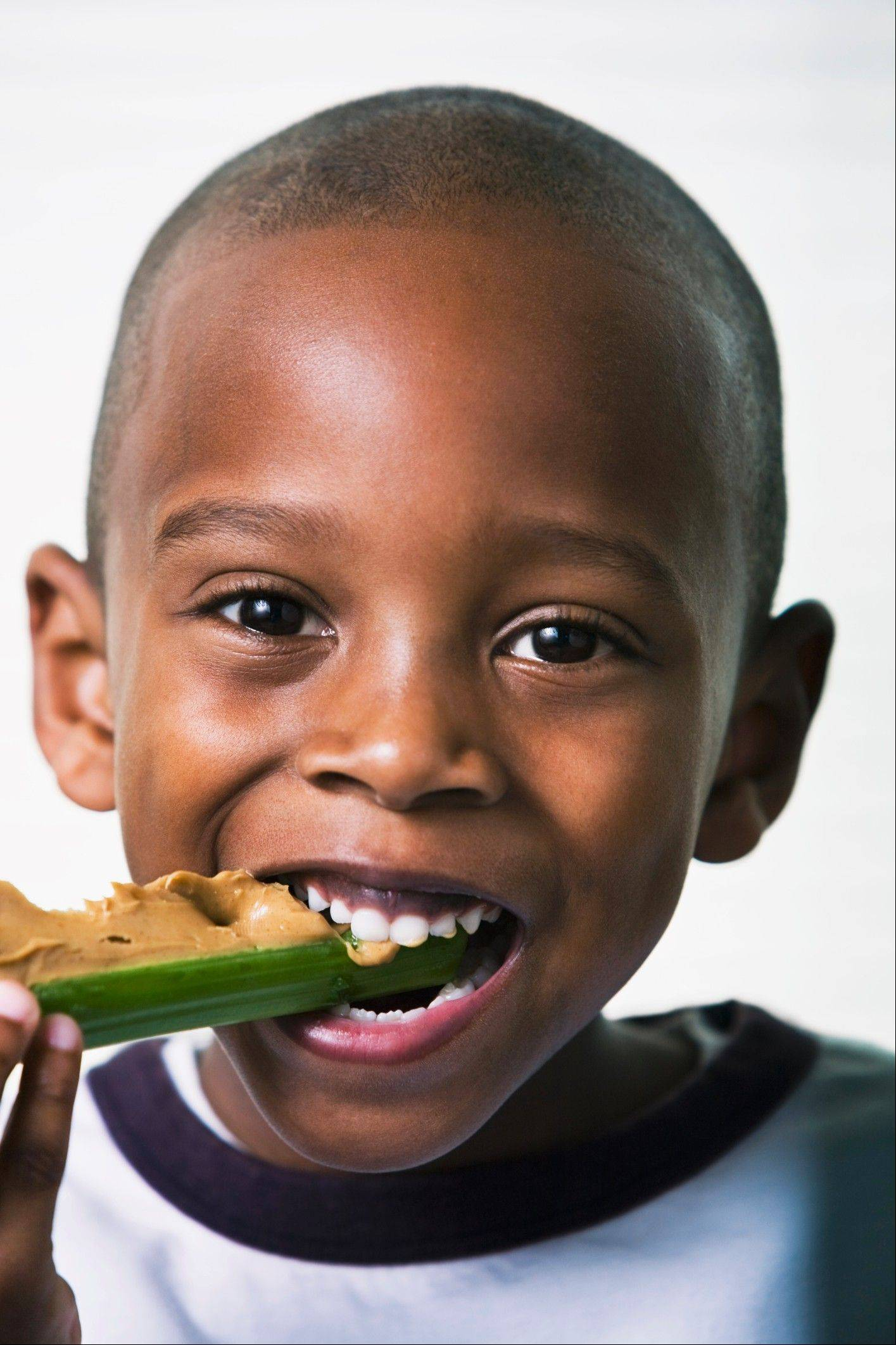 "Peanut butter on celery is a good standby for a healthful snack. Boost the nutrition by adding raisins for ""ants on a log."""