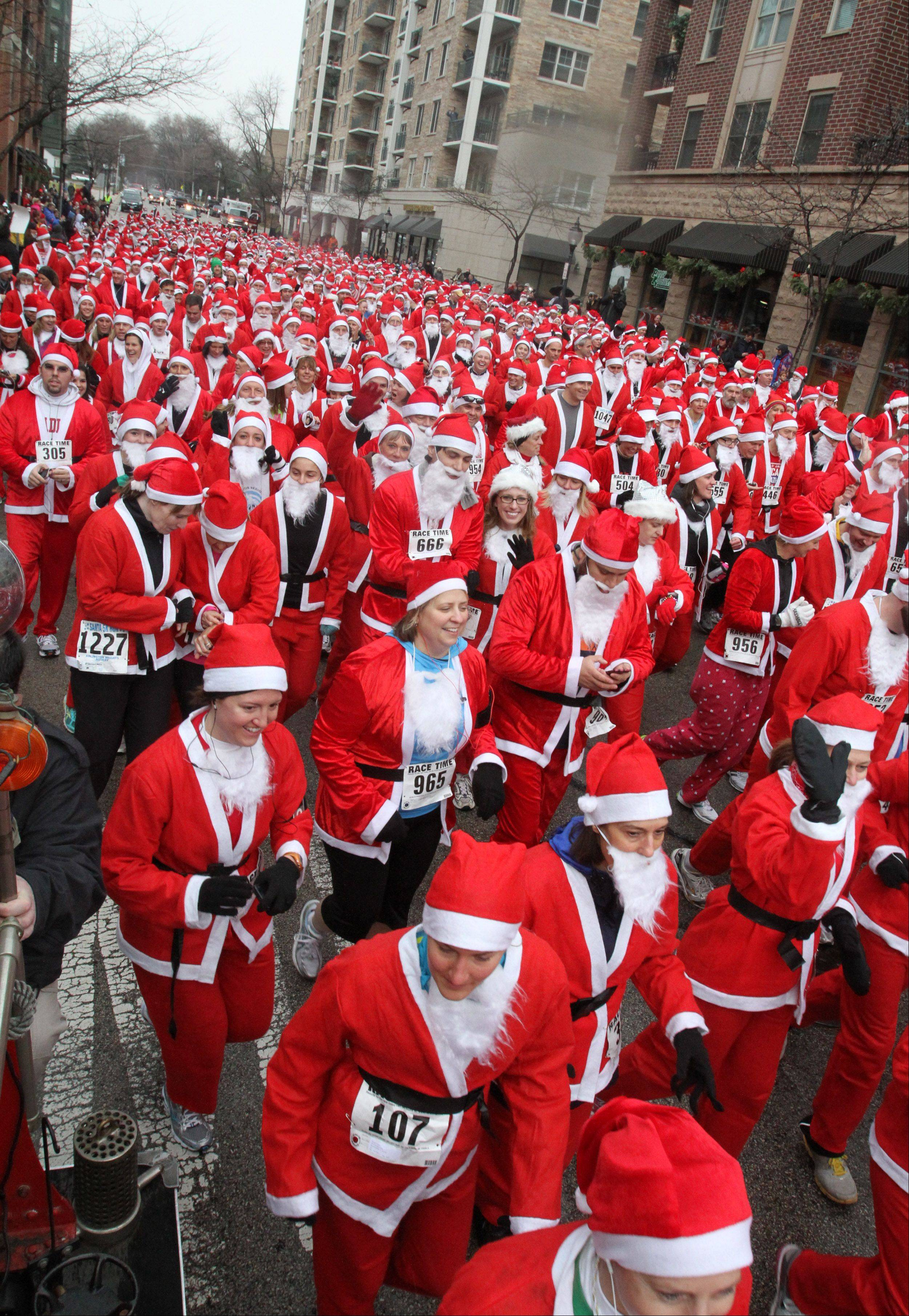 The Arlington Heights Rotary Club has 2,000 Santa suits available for this year's Rotary Santa Run on Saturday, Dec. 3.