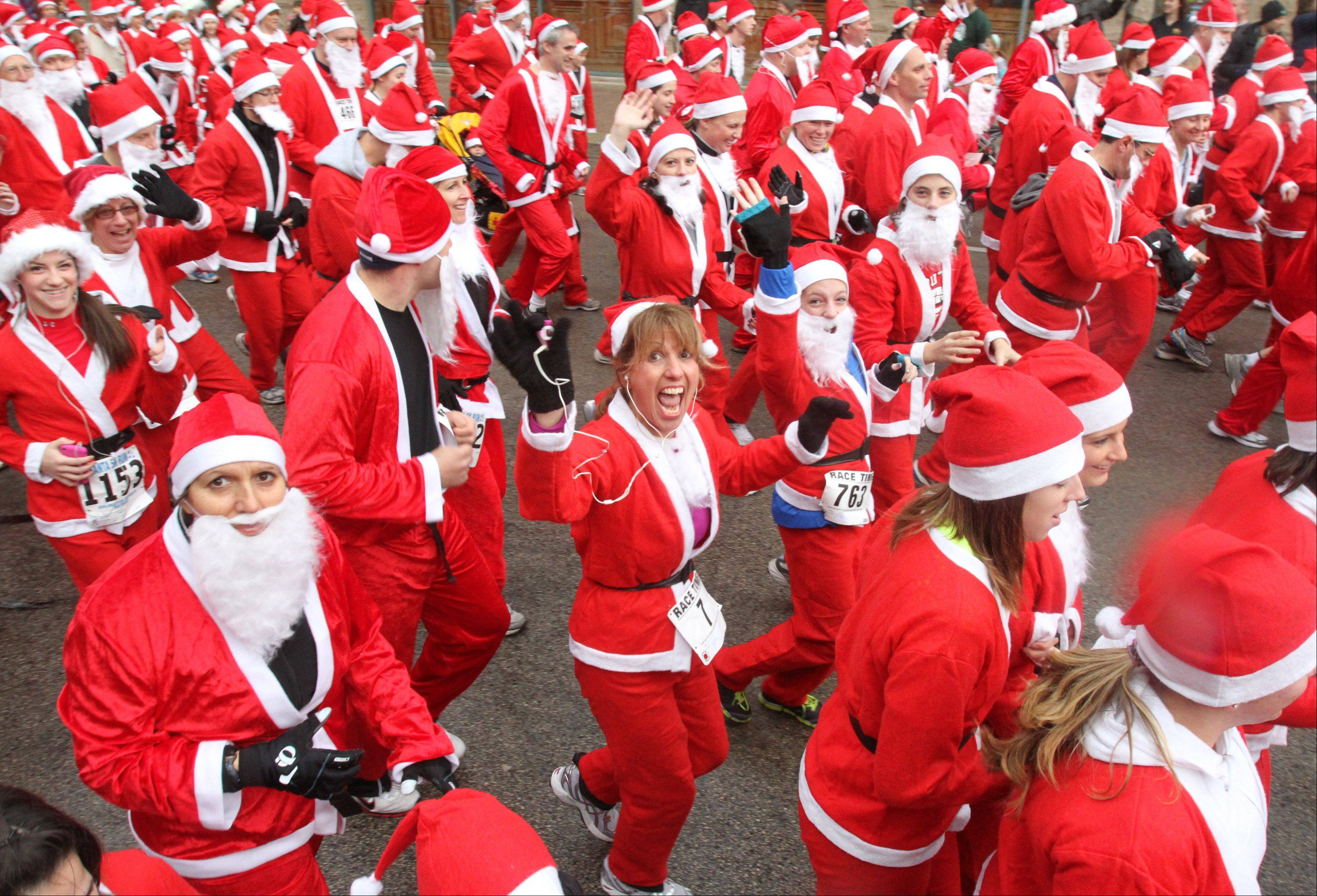 A light rain fell on runners at the start of last year's 5K Rotary Santa Run in Arlington Heights.