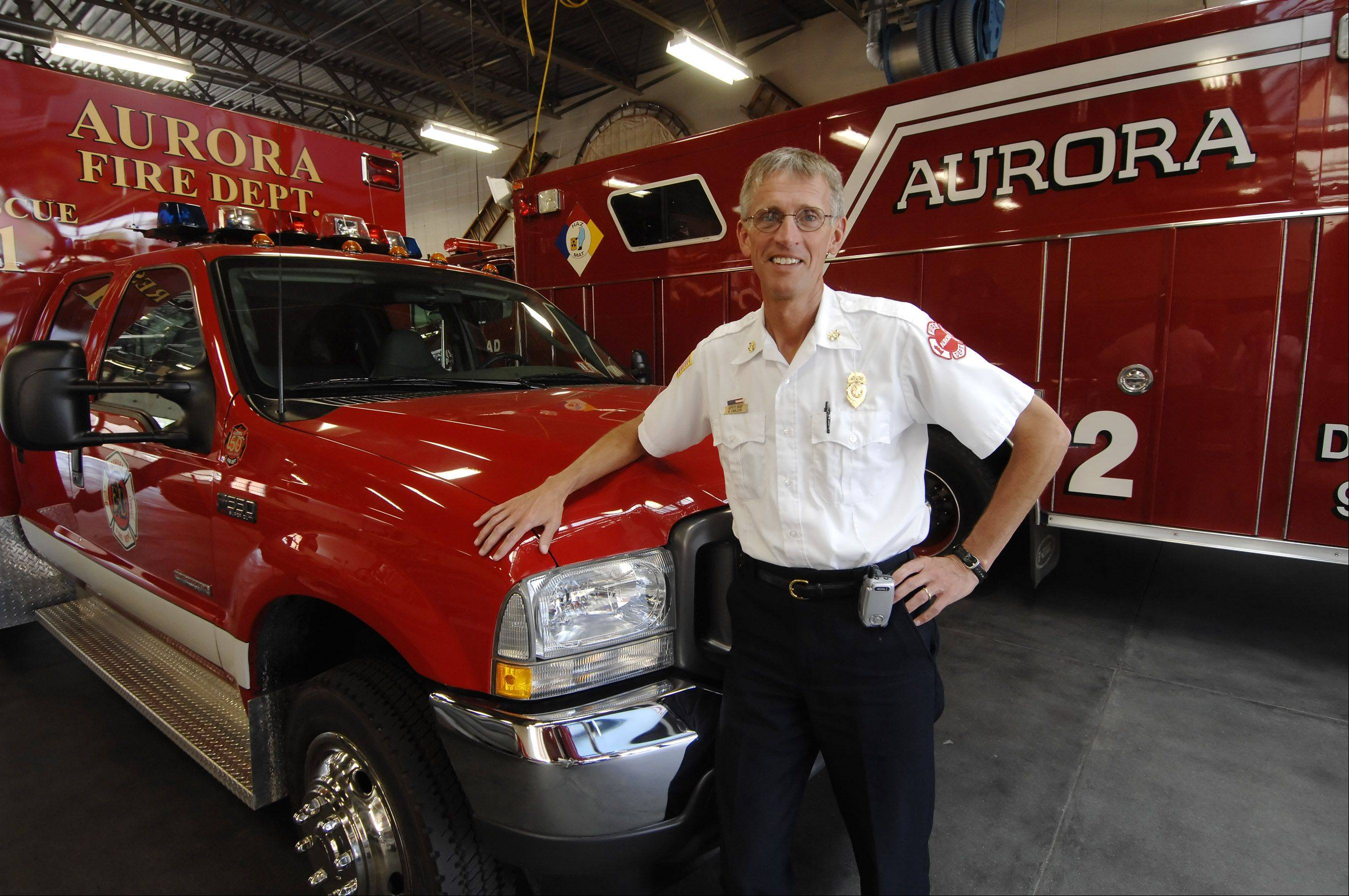 Hal Carlson, seen here in July 2009 as he began serving as Aurora fire chief, is retiring Thursday after 30 years with the department.