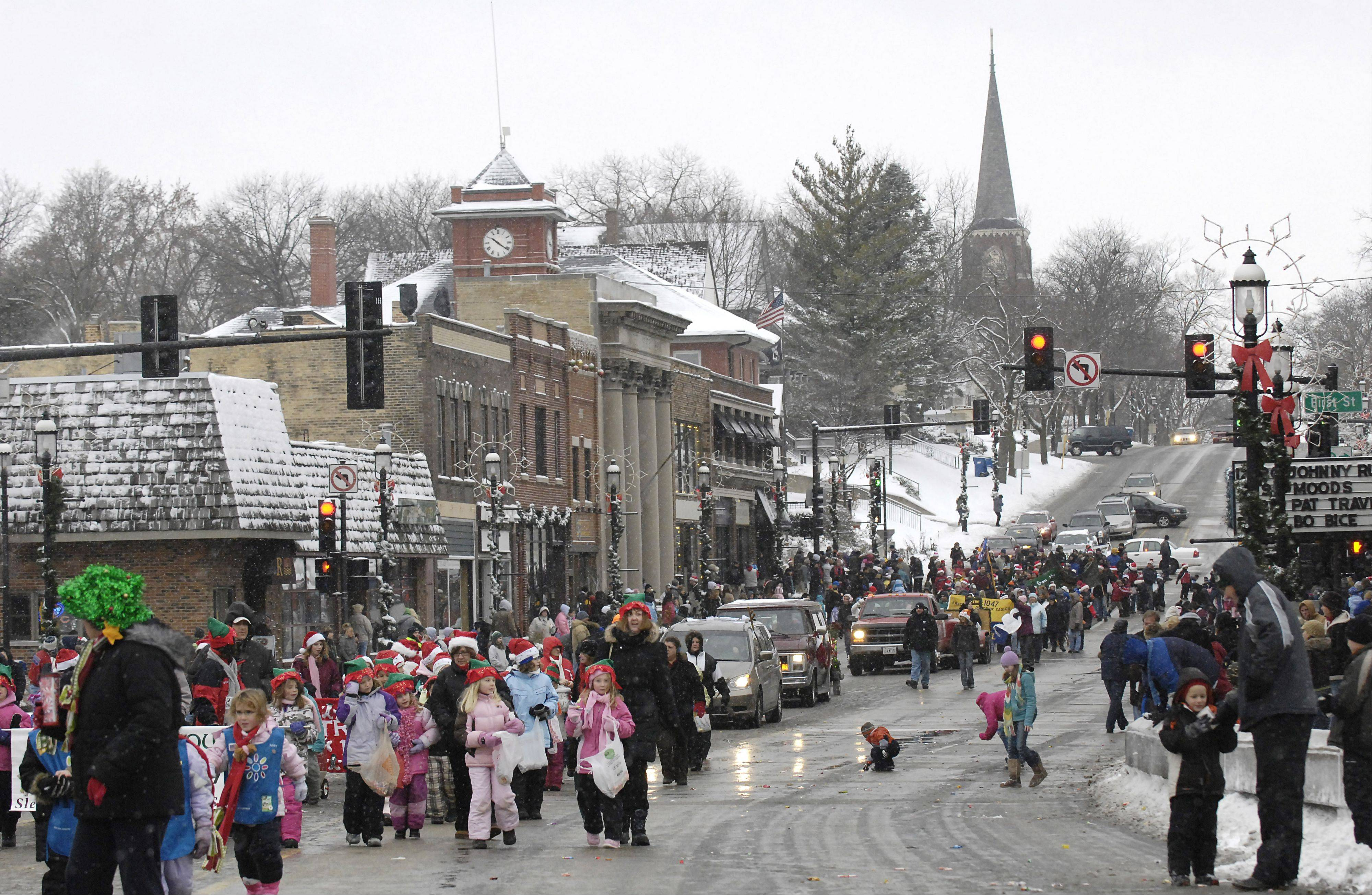 Girl Scout troops make their way down Main St. in downtown Dundee in the Spirit of Christmas parade at a previous Dickens in Dundee festival. This year will be the festival's 25th anniversary.