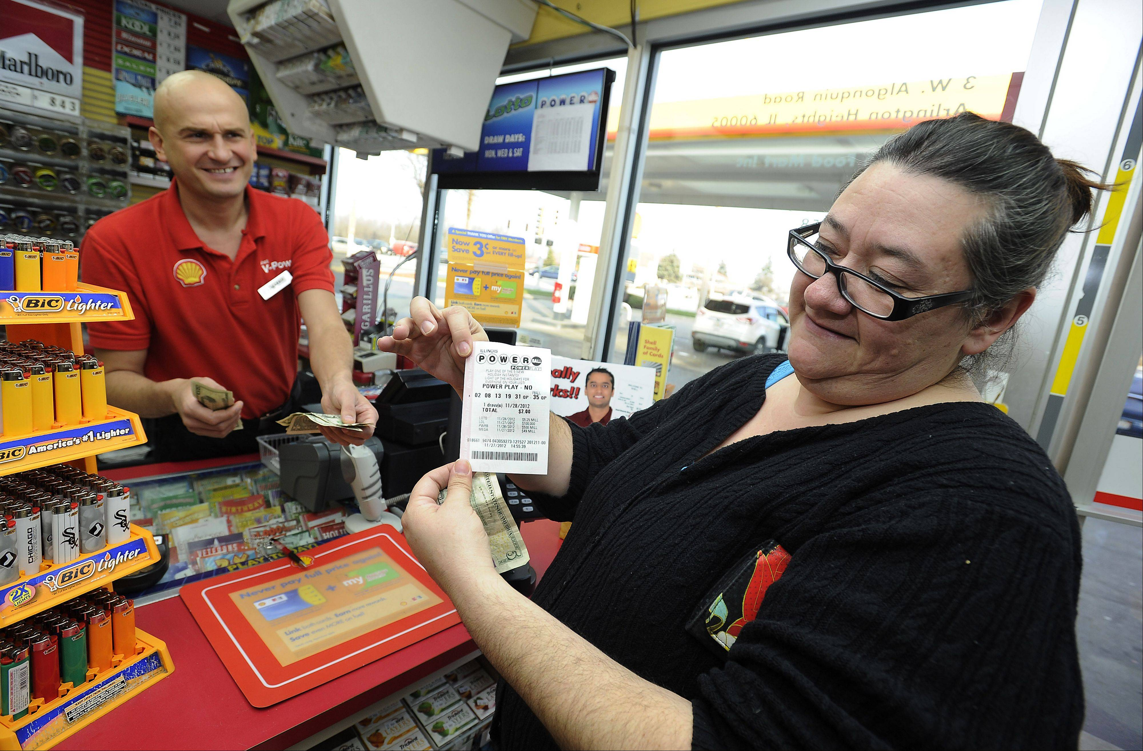 Diana Deleon of Chicago just purchased her $500 million powerball winning ticket (she hopes) from Shell gas station clerk Marko Stojiljkovic on Tuesday, one day before the big drawing.