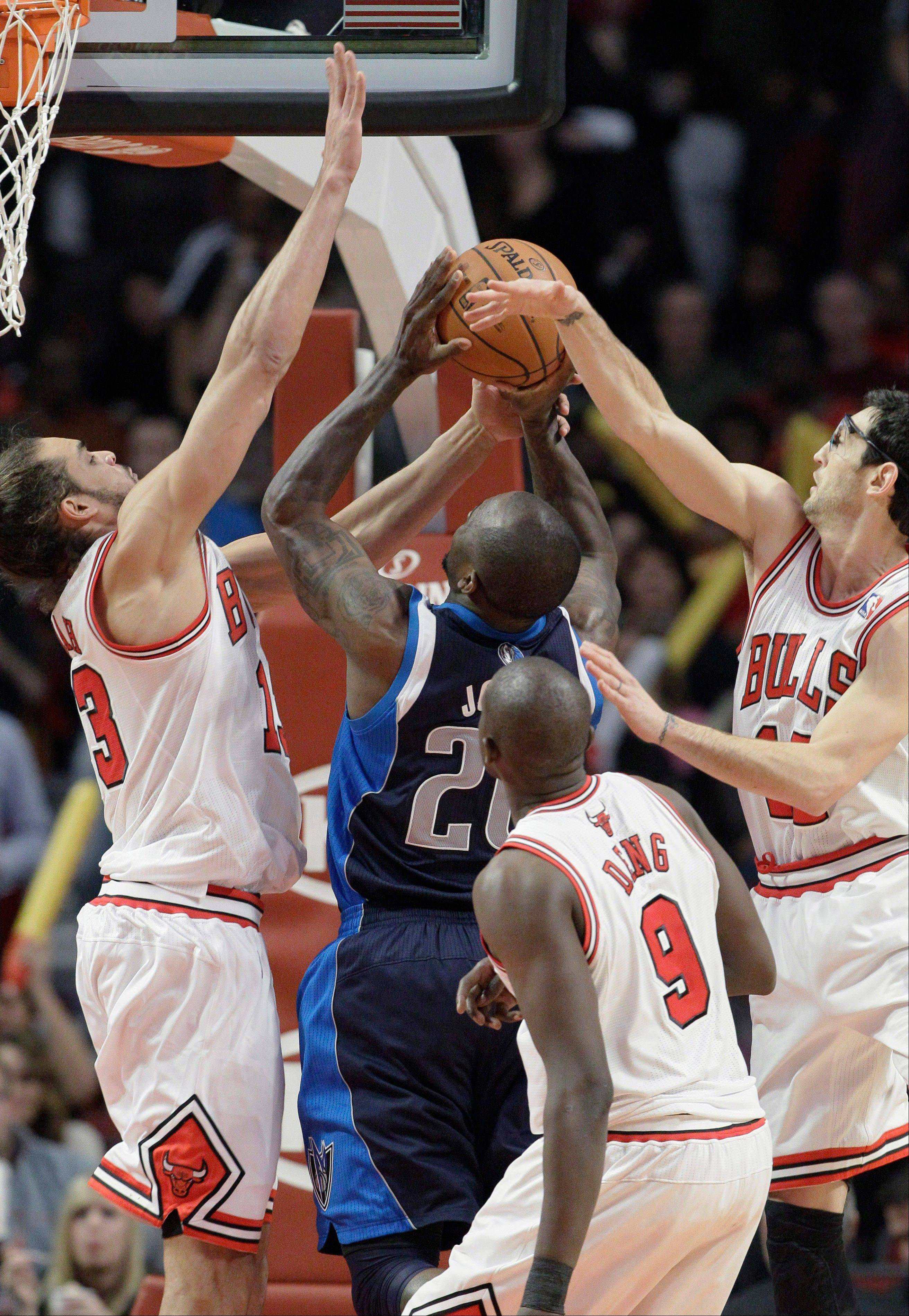 Bulls center Joakim Noah (13), guard Kirk Hinrich (12) and forward Luol Deng (9) apply the defense on the Mavericks' Dominique Jones during the second half Wednesday night.