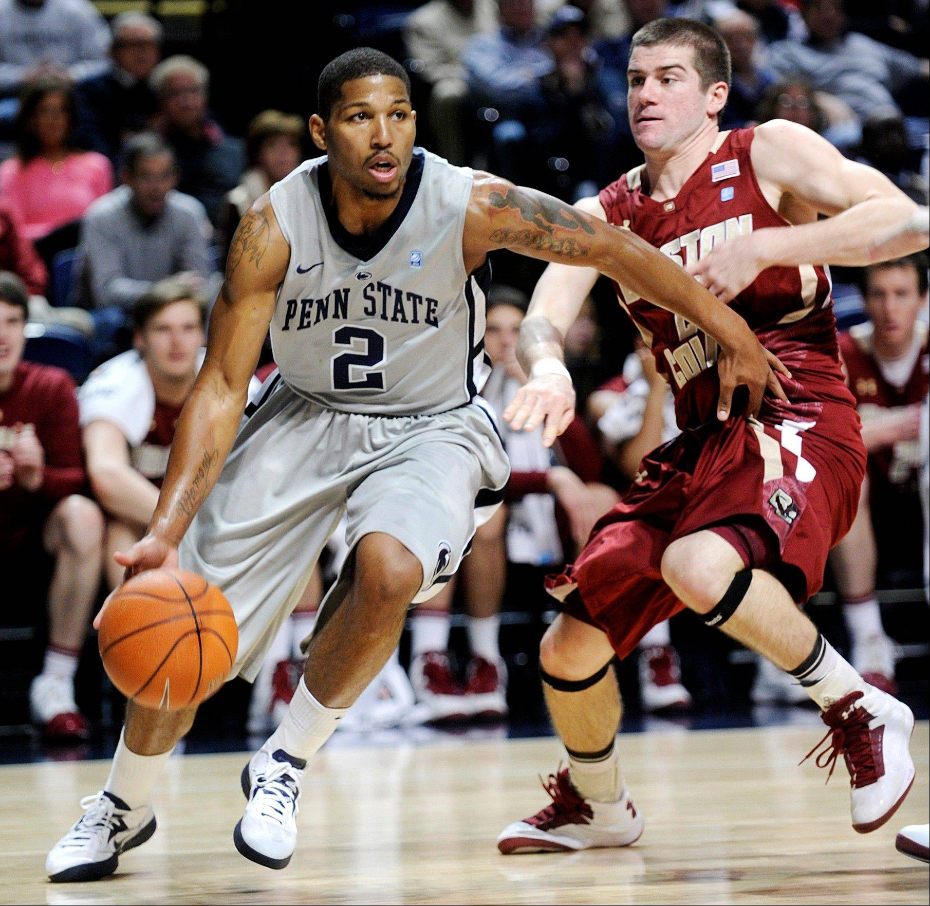 Penn State's D.J. Newbill dribbles around Boston College's Joe Rahon Wednesday in State College, Pa.