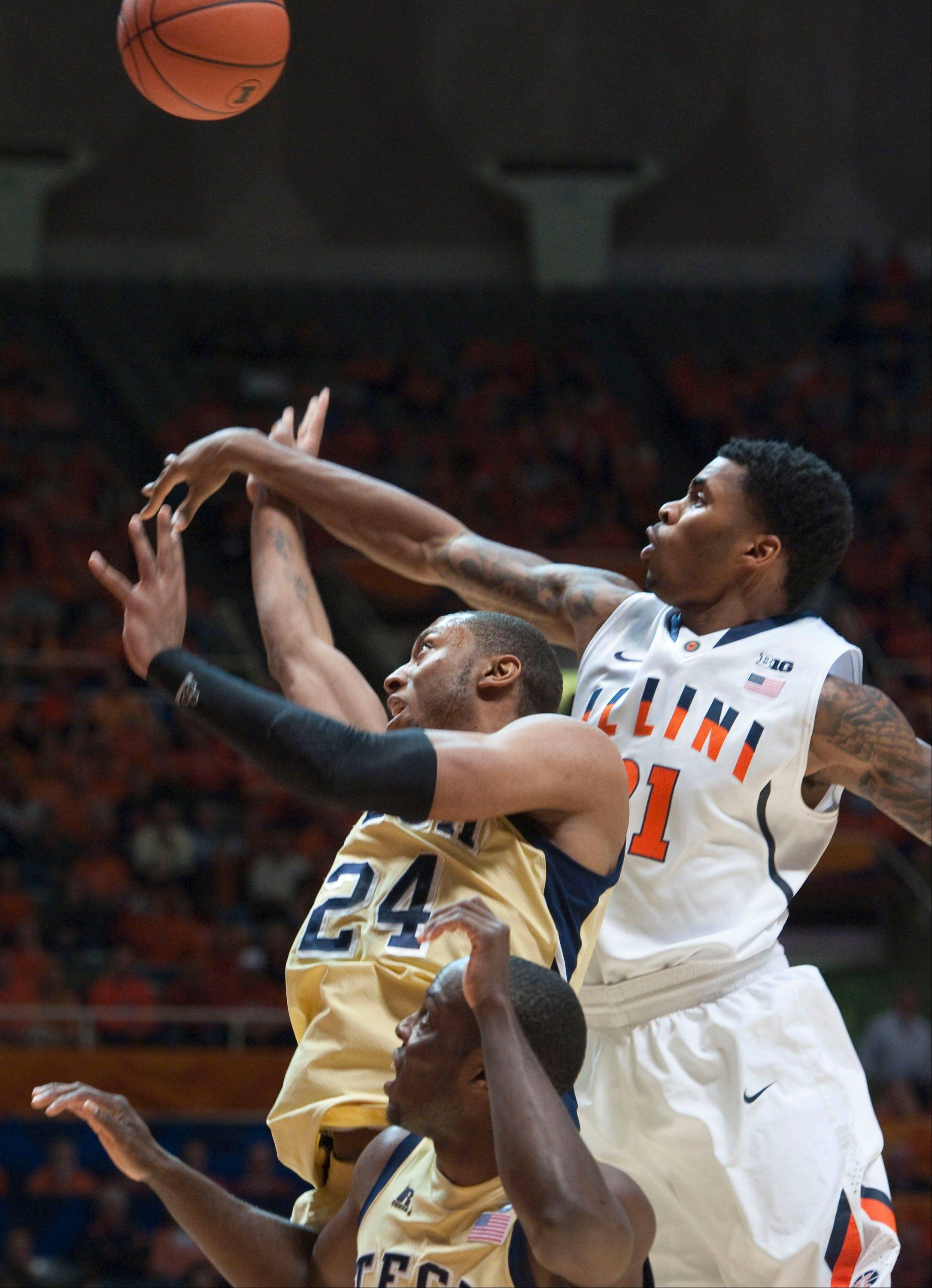 Illinois' Devin Langford swats the ball from Georgia Tech Kammeon Holsey Wednesday during the first half in Champaign.