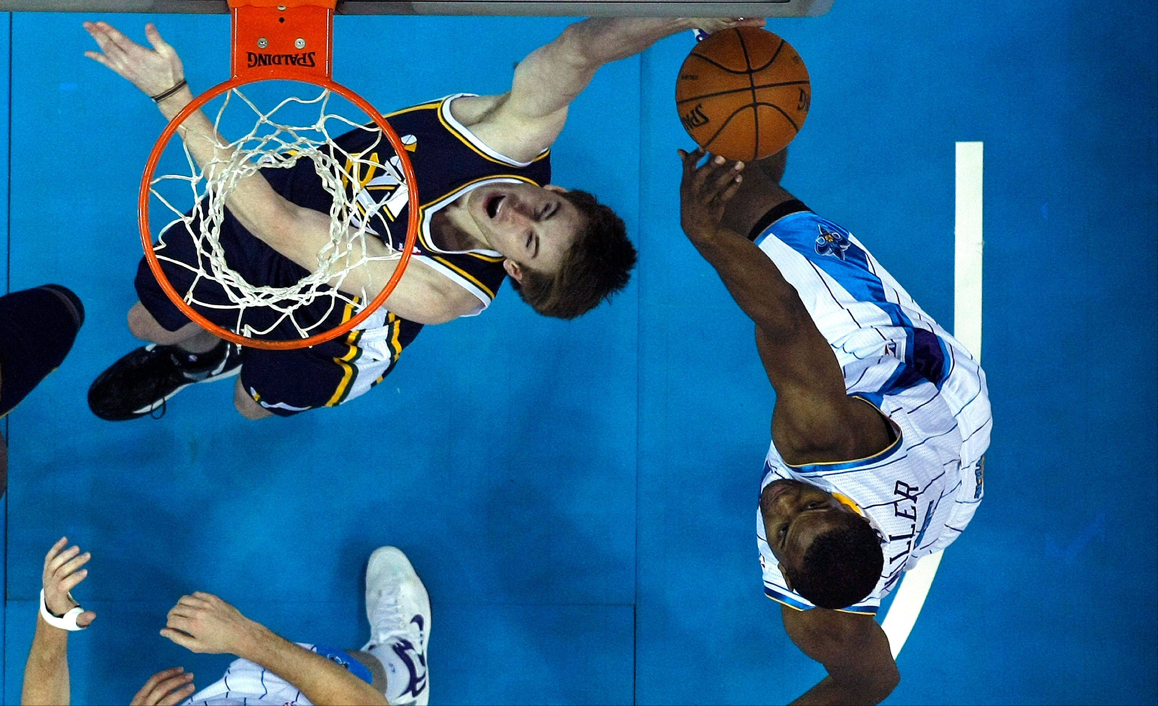 Utah Jazz guard Gordon Hayward (20) battles under the basket with New Orleans Hornets forward Darius Miller Wednesday during the first half in New Orleans.