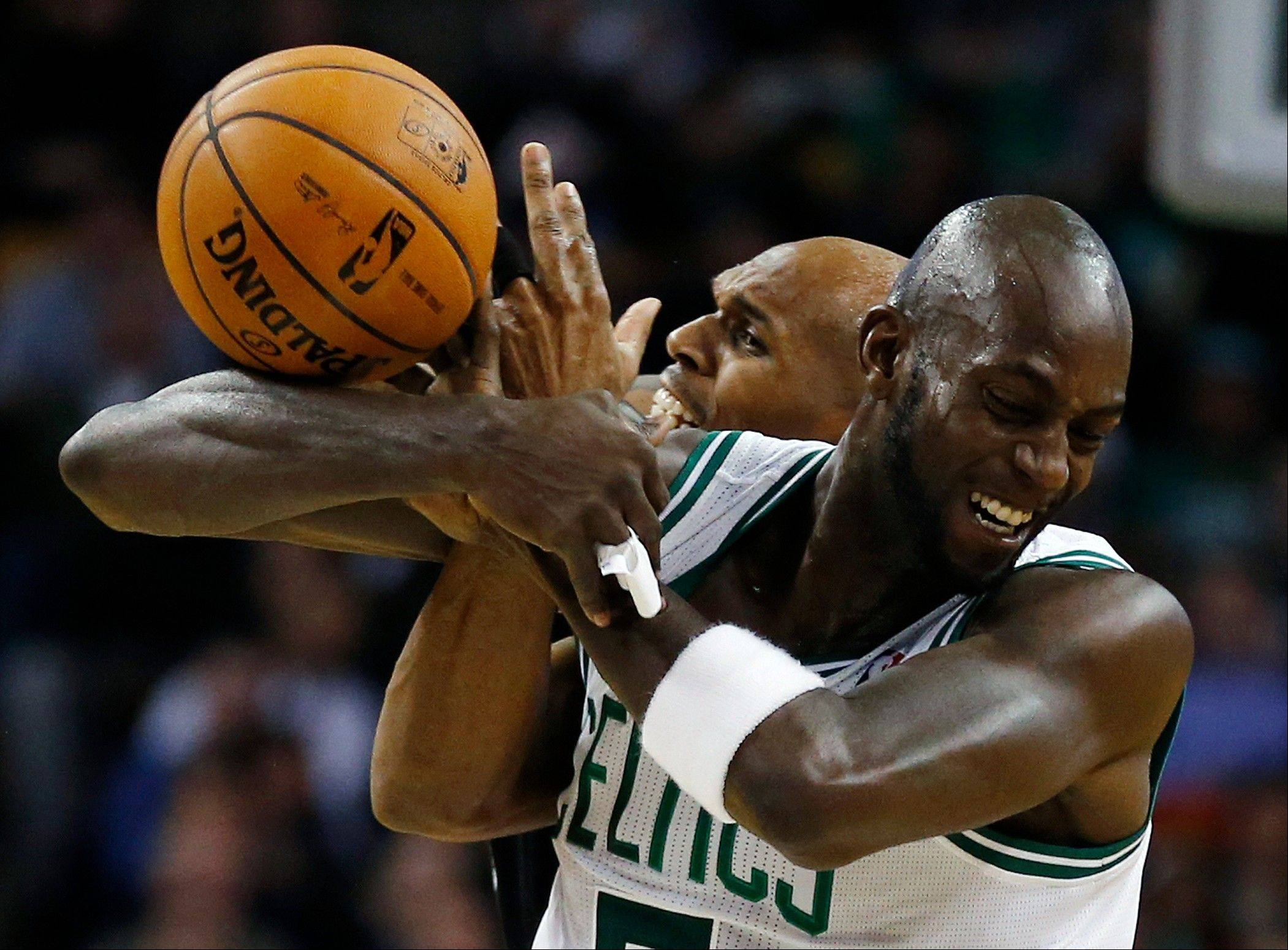 Boston Celtics forward Kevin Garnett, right, and the Brooklyn Nets' Jerry Stackhouse battle for a loose ball Wednesday during the second quarter in Boston.