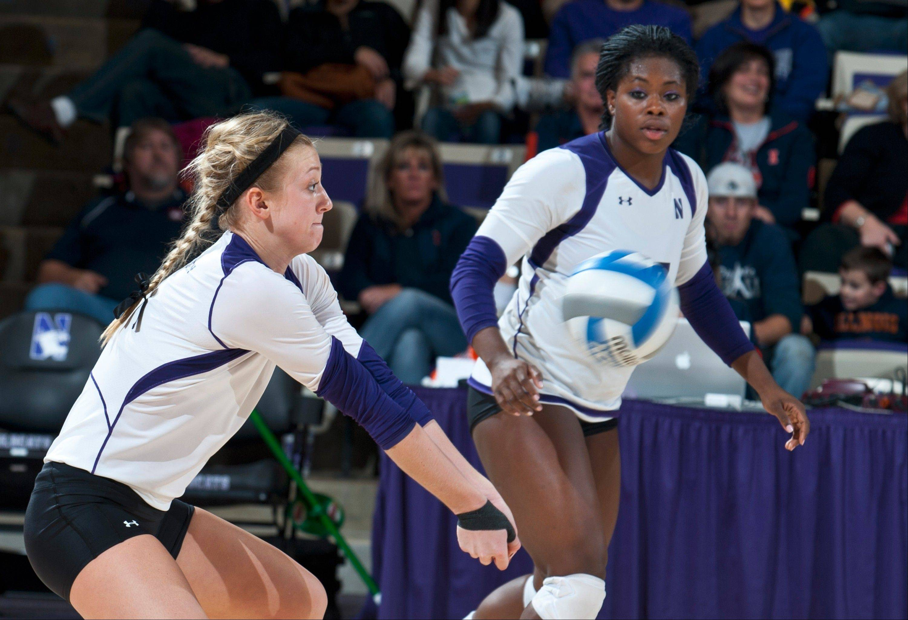 Burlington Central graduate Stephanie Holthus, left, is having a stellar junior season for the Northwestern University women's volleyball team.