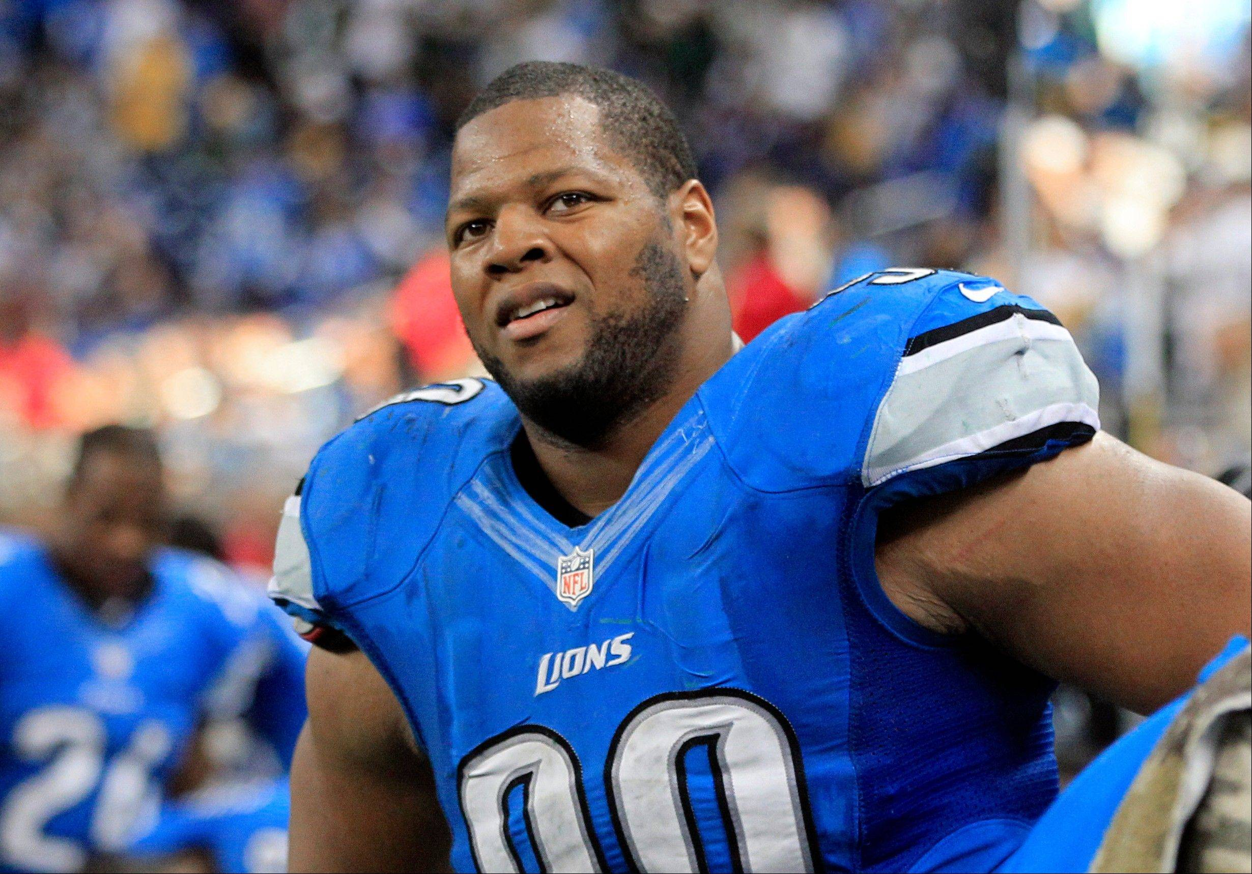 Detroit Lions defensive tackle Ndamukong Suh was fined $30,000 by the NFL on Wednesday, but says he didn't kick Houston Texans quarterback Matt Schaub on purpose.
