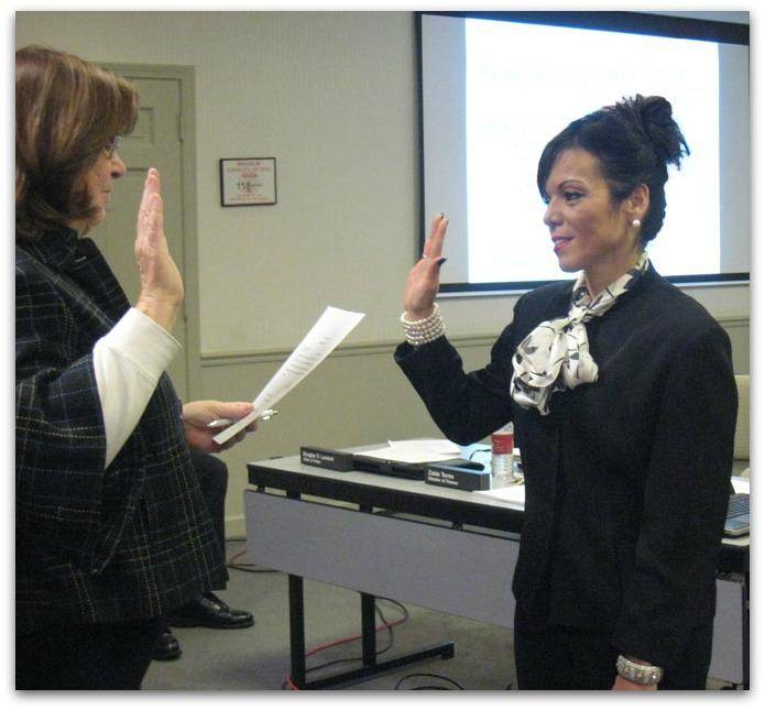New Village Administrator Zaida Torres takes the oath of office from Wauconda Village Clerk Ginger Irwin on November 27th.