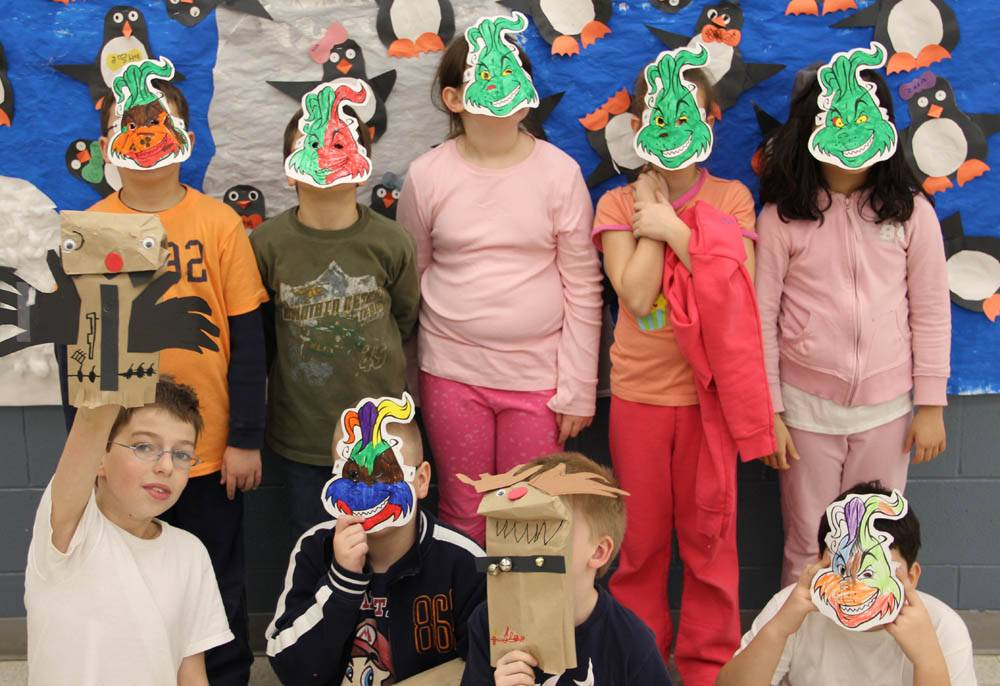Children work on holiday craft projects in Way Fun Winter Break Camp.