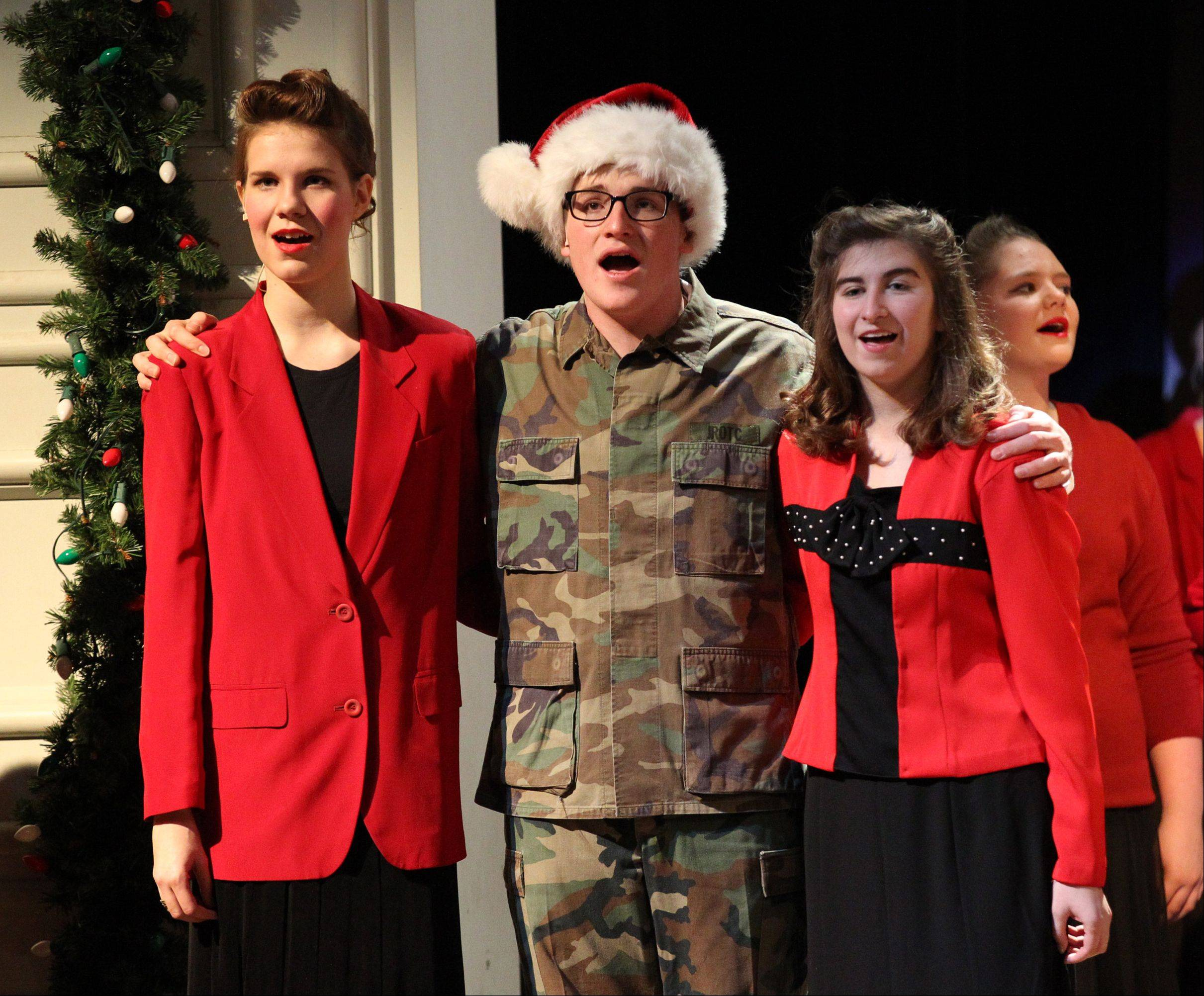 "Melody FisherLewek, Brian Winkel and Emily Burback rehearse a number from ""White Christmas,"" which will be staged this weekend at Rosary High School in Aurora. Behind them is Taylor James. The girls are members of the ensemble, and Brian Winkel plays Ralph Sheldrake."