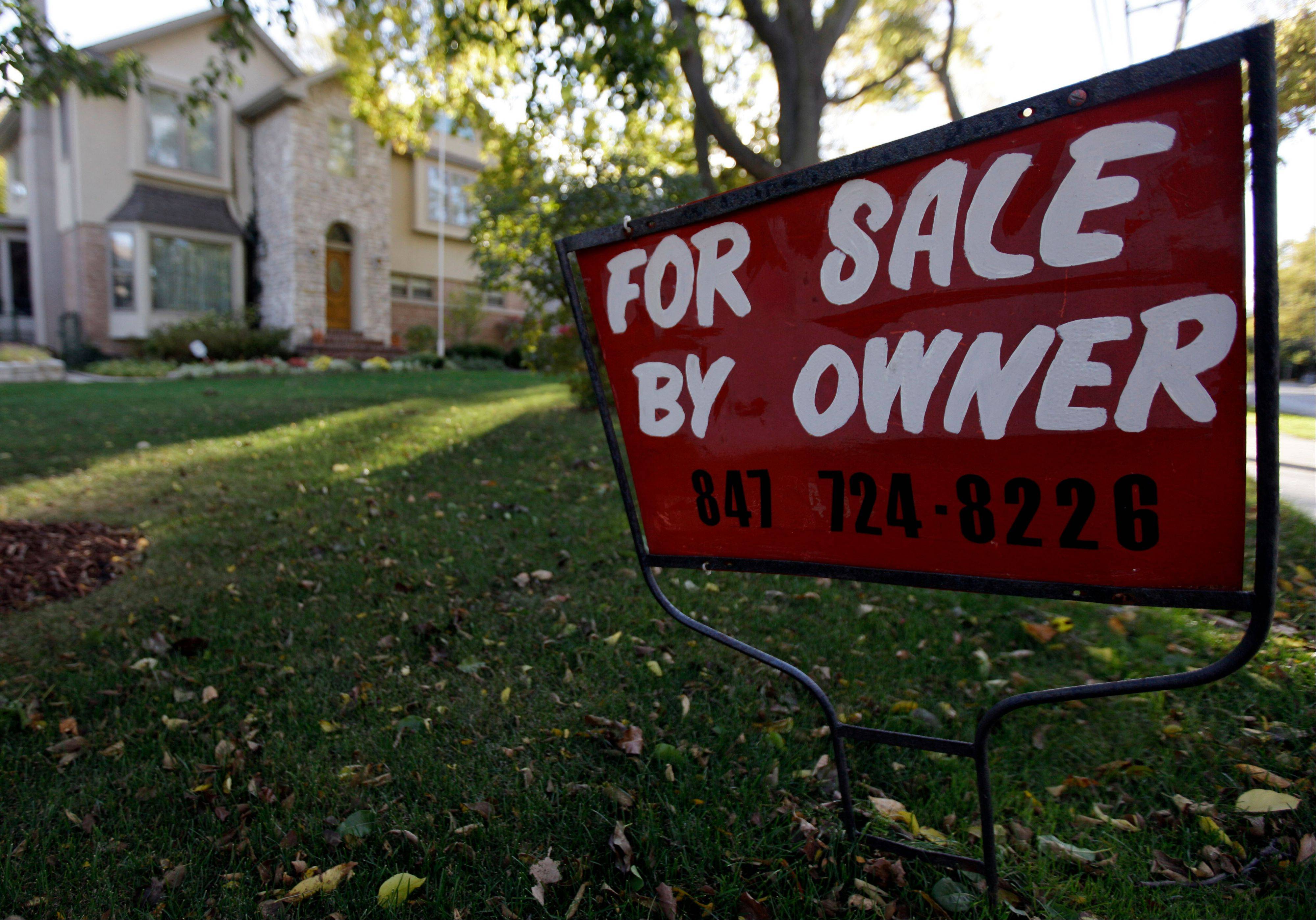 An index measuring the number of Americans who signed contracts to buy homes in October jumped to nearly its highest level in almost six years. Steady job gains and record-low mortgage rates have made home buying more attractive.