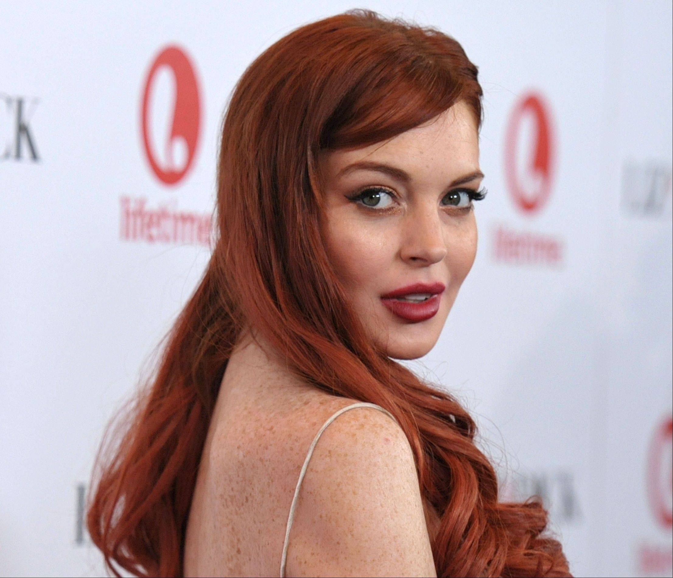 Lindsay Lohan was arrested and charged with third-degree assault early Thursday after police say she hit a woman during an argument at a New York City nightclub.