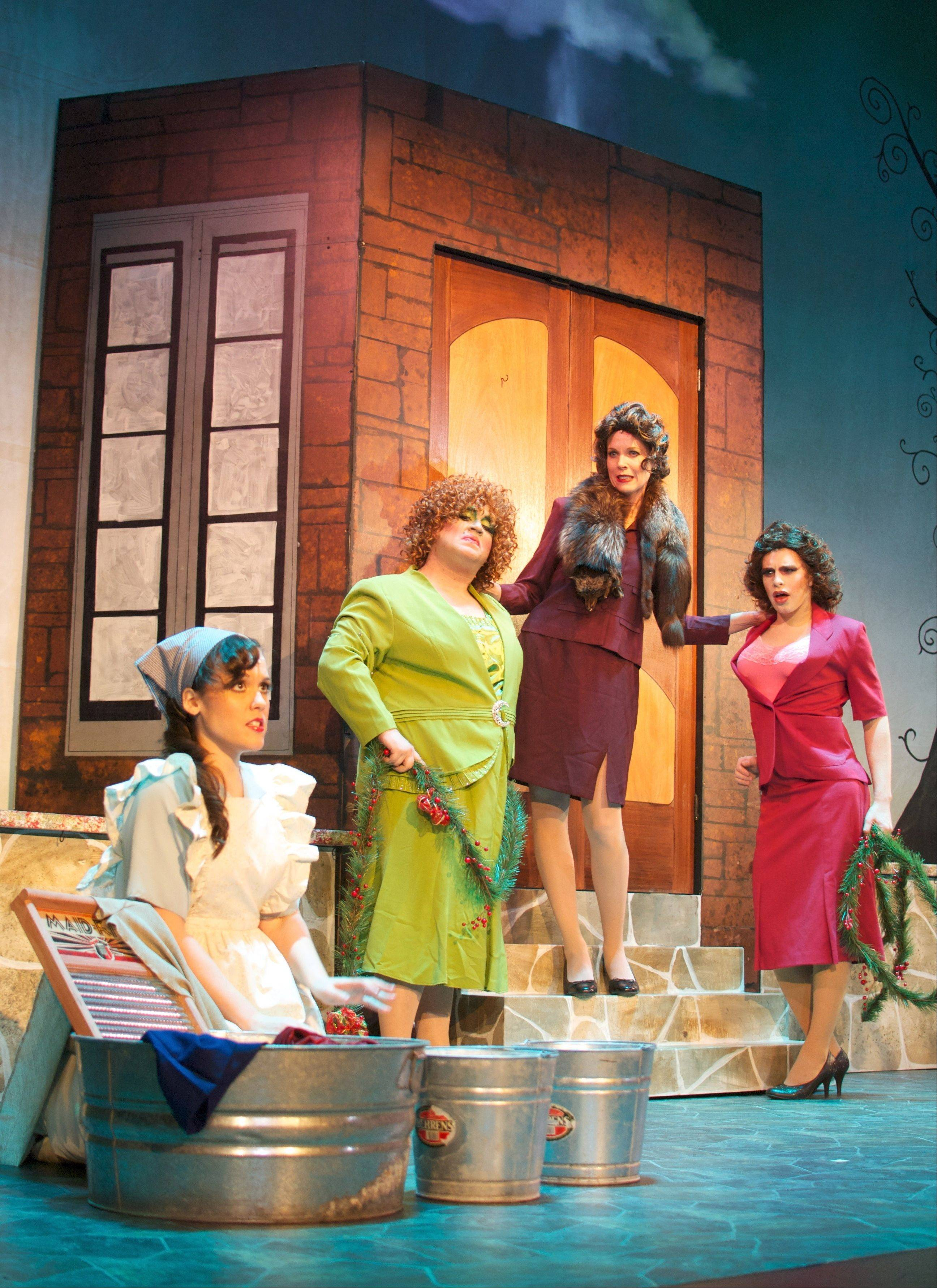 "Cinderella (Missy Karle) washes clothes while her evil family hovers behind her in the Emerald City Theatre's production of ""Cinderella."" The evil family includes stepsister Grace (Tommy Bullington), left, stepmother (Heather Townsend) and stepsister Temperance (Mark Kosten)."