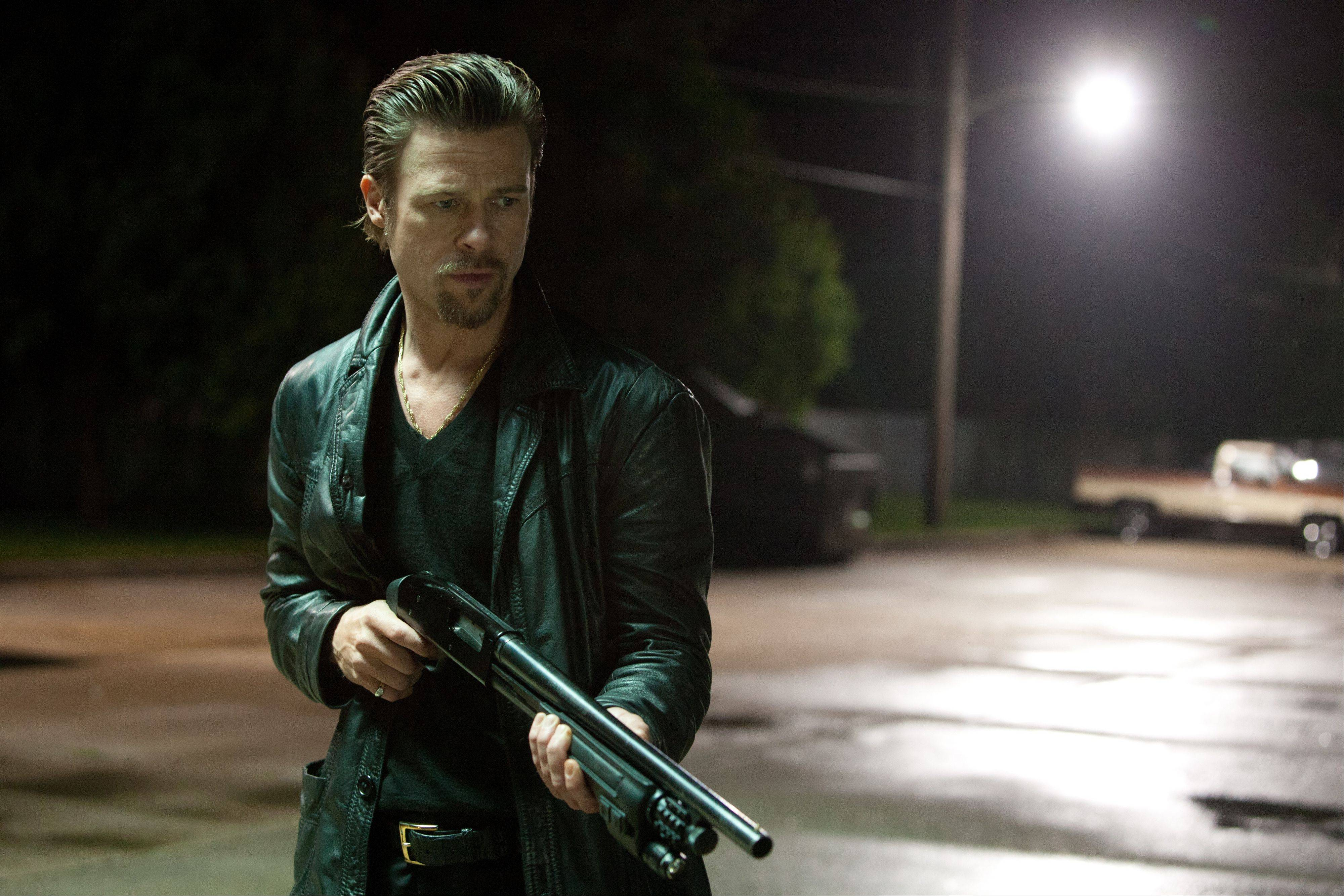 "Corporate mob hit man Jackie Cogan (Brad Pitt) takes care of business in Andrew Dominik's violent and talky ""Killing Them Softly."""