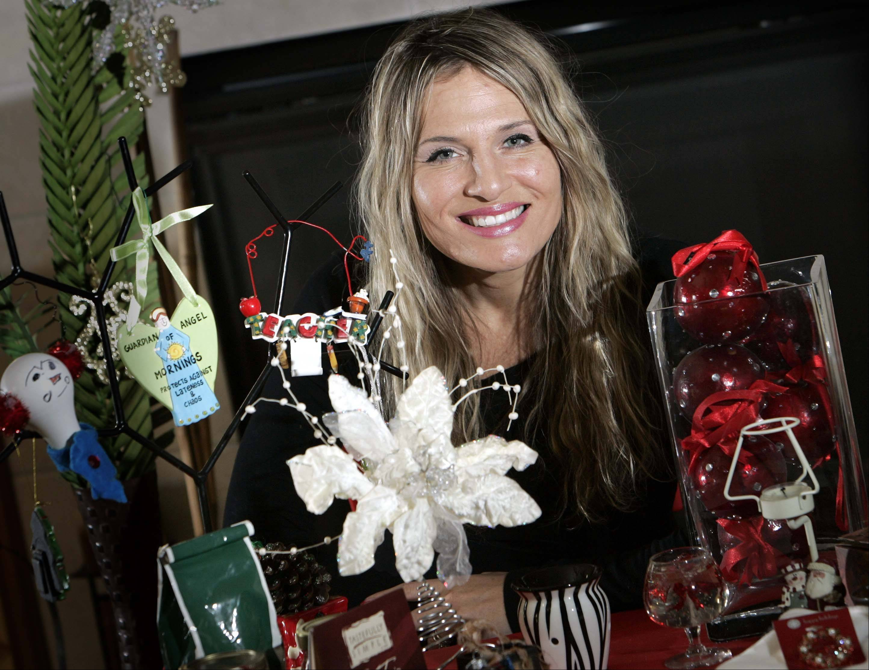 Second-grade Channing Elementary School teacher Tamika Morales poses with just a sampling of the gifts that she has received over her six years as a teacher in Elgin.