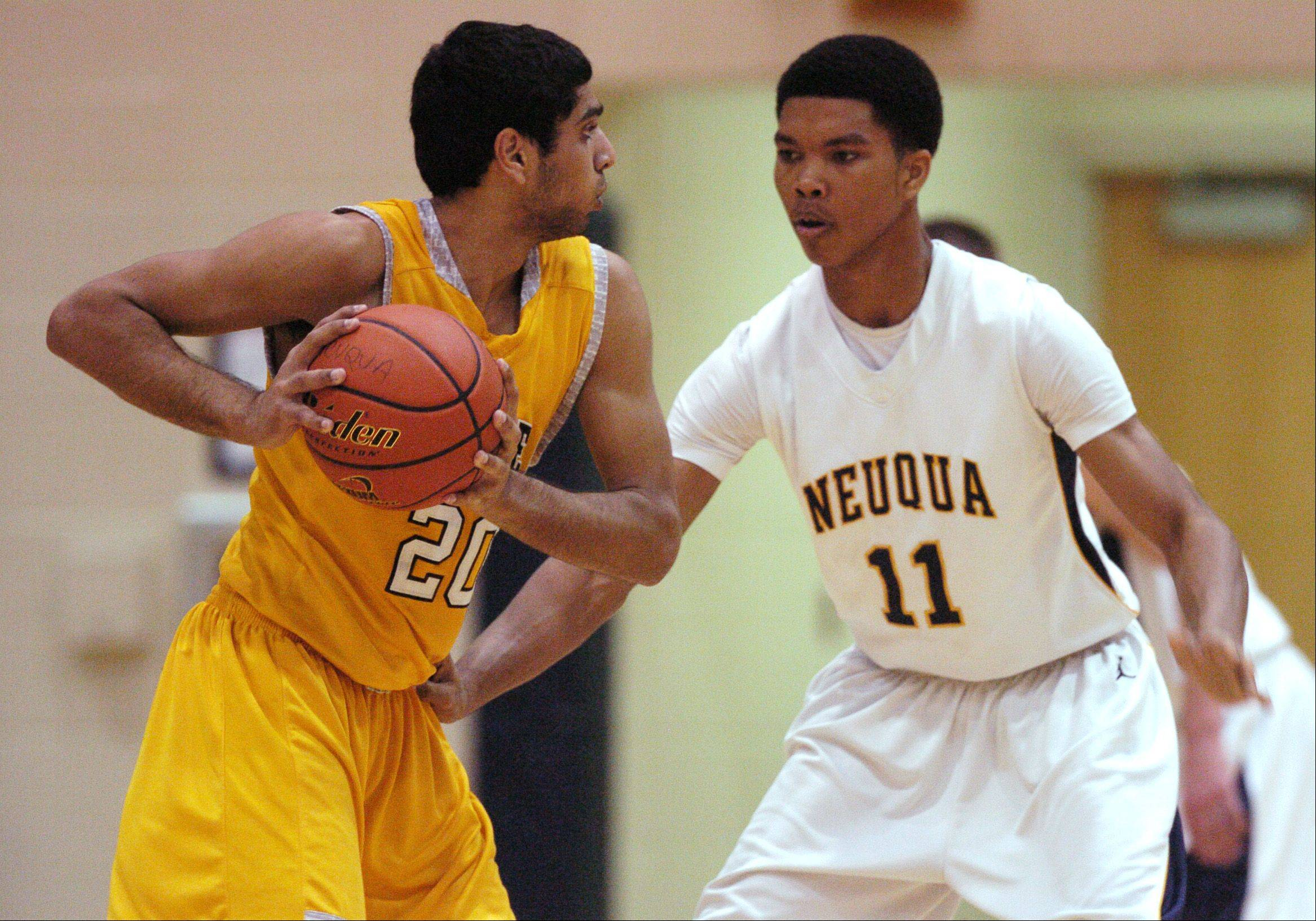 Vin Patel of Metea Valley looks to pass around Zach Pugh of Neuqua Valley during varsity boys basketball Thursday at Neuqua Valley.