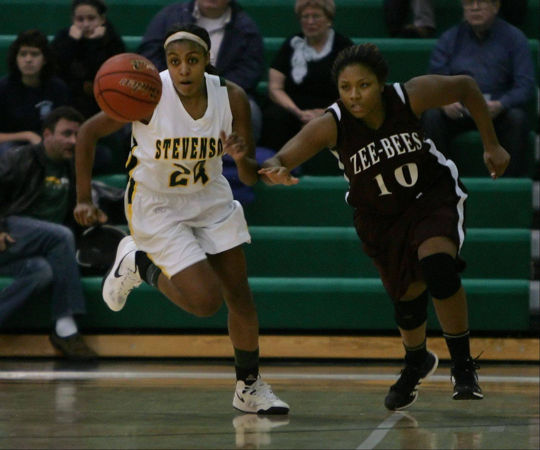 Stevenson forward Taylor Buford steals the ball away from Zion-Benton forward Keonnia Gentry in the first quarter.