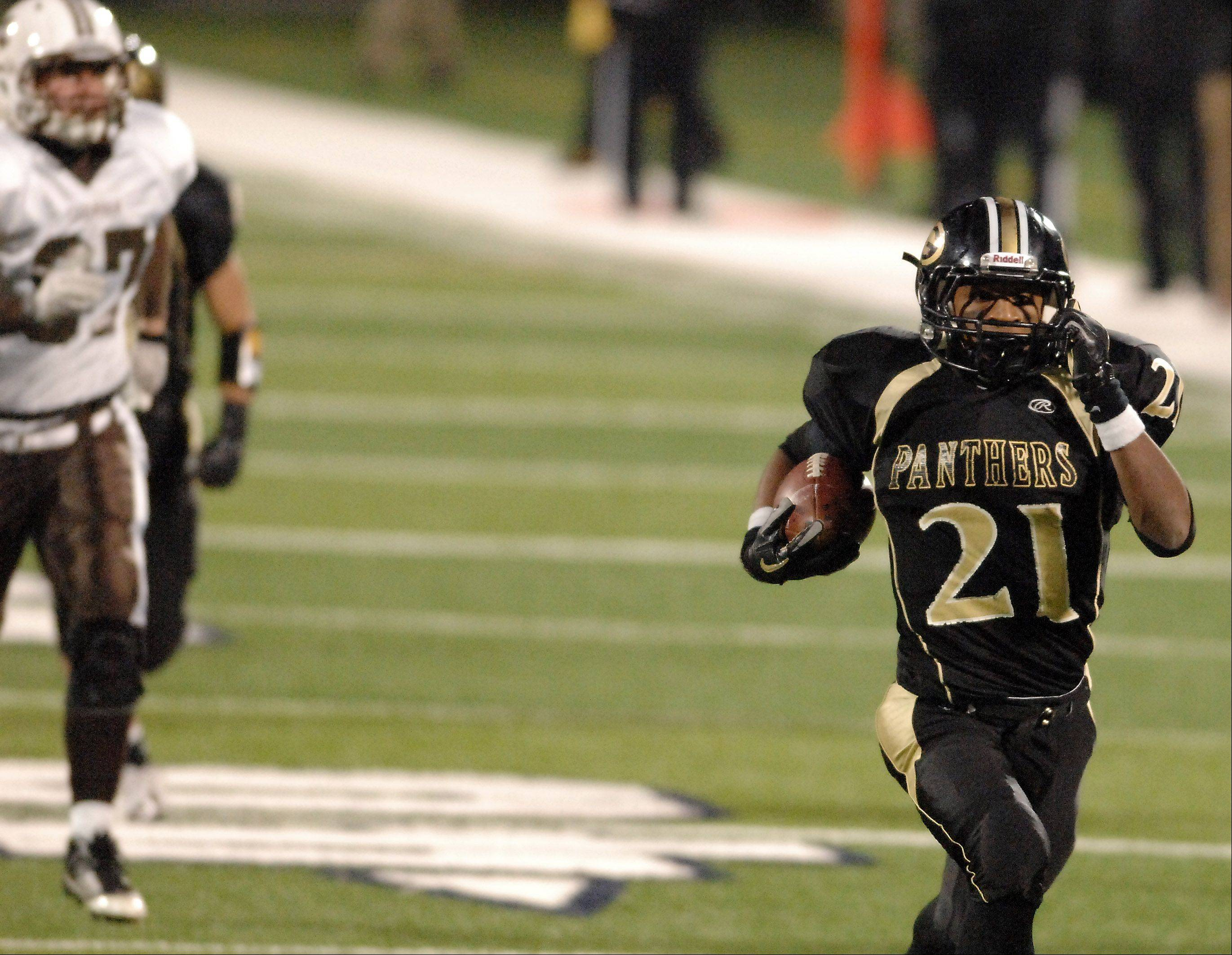 Glenbard North�s Justin Jackson races to the end zone for a touchdown after aninterception during Saturday�s Class 8A state title game at Memorial Stadium in Champaign.