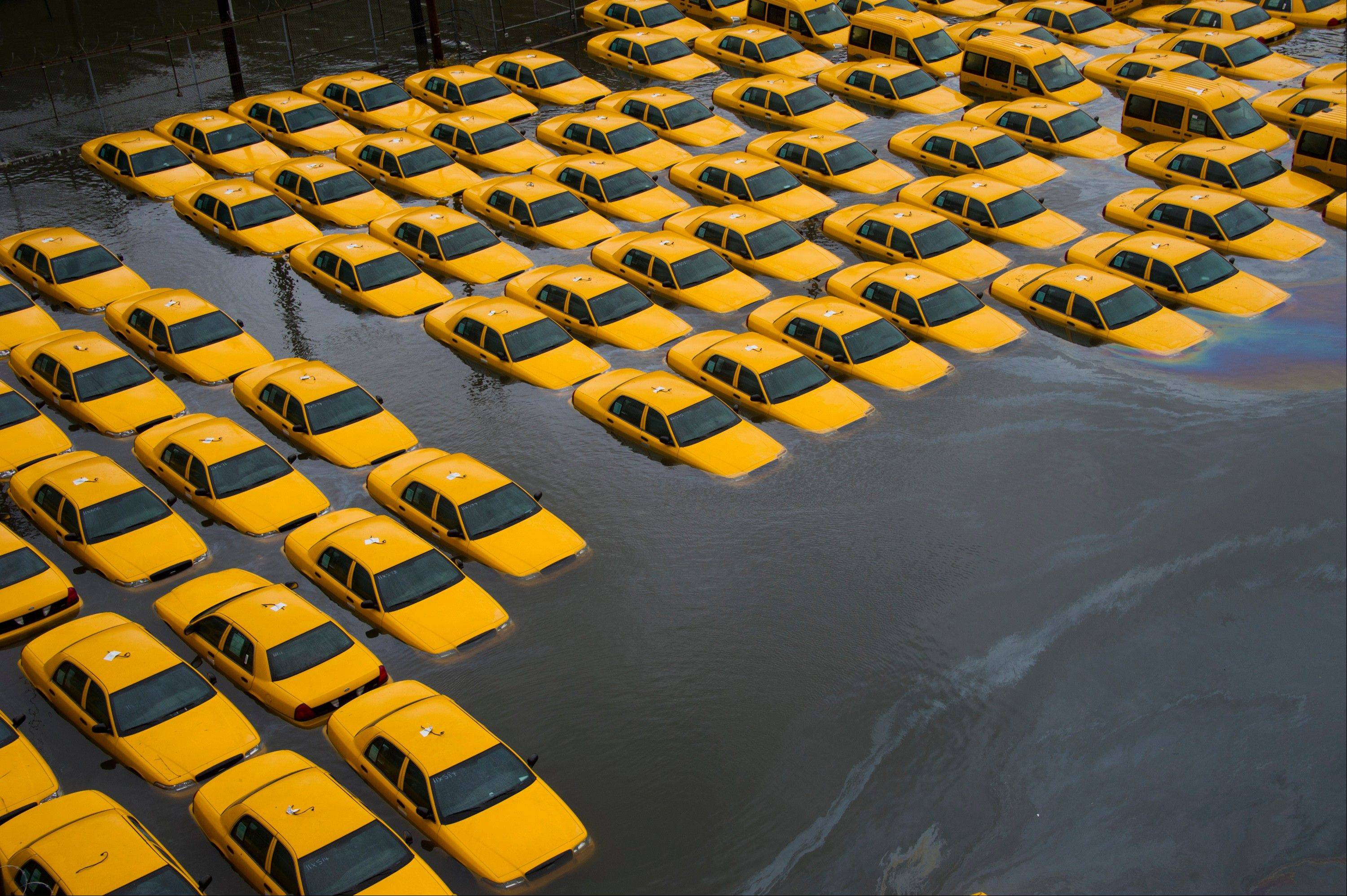 In this Oct. 30 file photo, a parking lot full of yellow cabs is flooded as a result of Superstorm Sandy in Hoboken, N.J. Sandy damaged or destroyed several homes and businesses, more than 72,000 in New Jersey alone, according to Gov. Chris Christie.