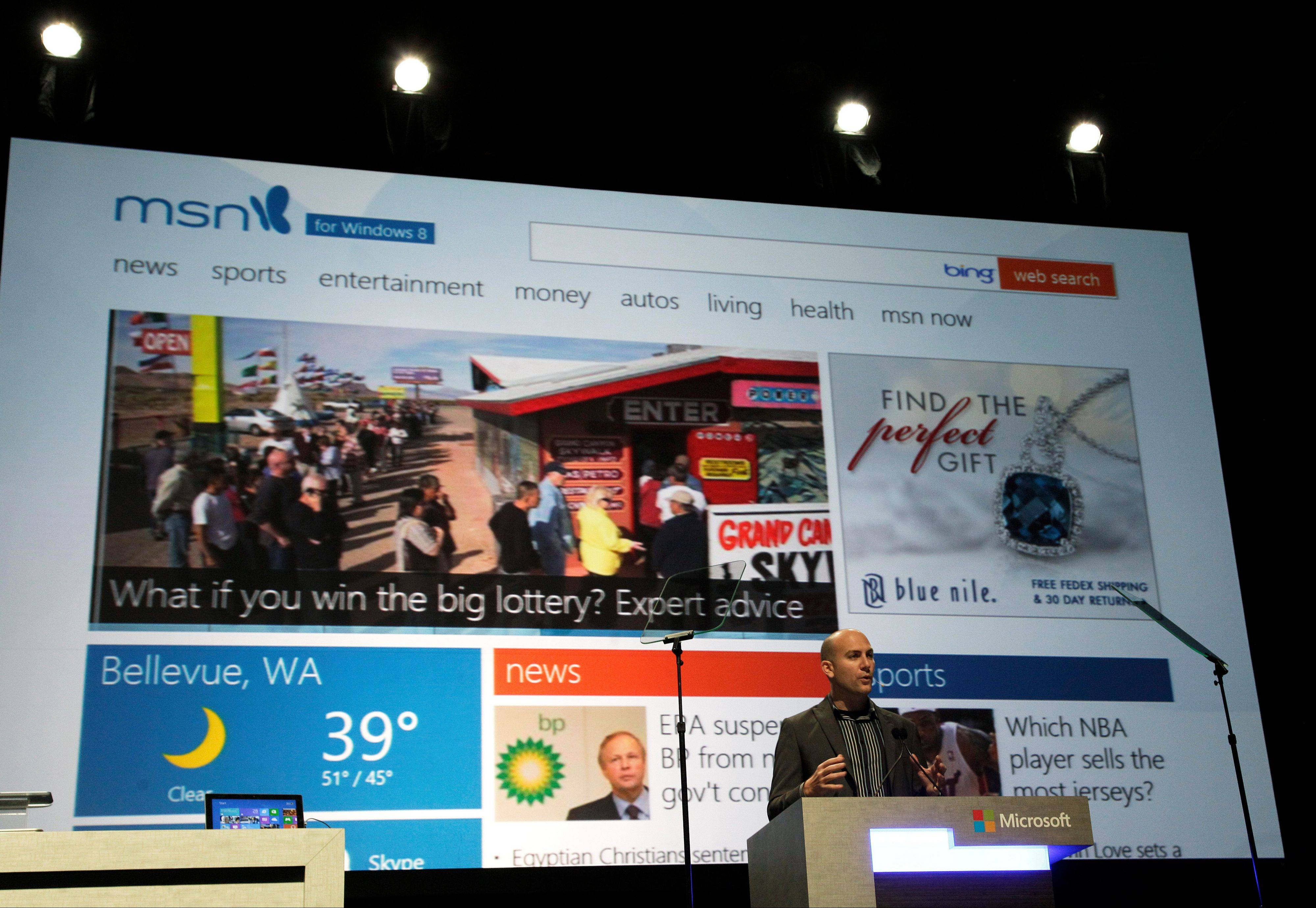 Ryan Asdourian, Microsoft Corp. Senior Product Manager for Windows, speaks in front of an MSN.com website screen during Microsoft's annual meeting of shareholders, Wednesday in Bellevue, Wash.