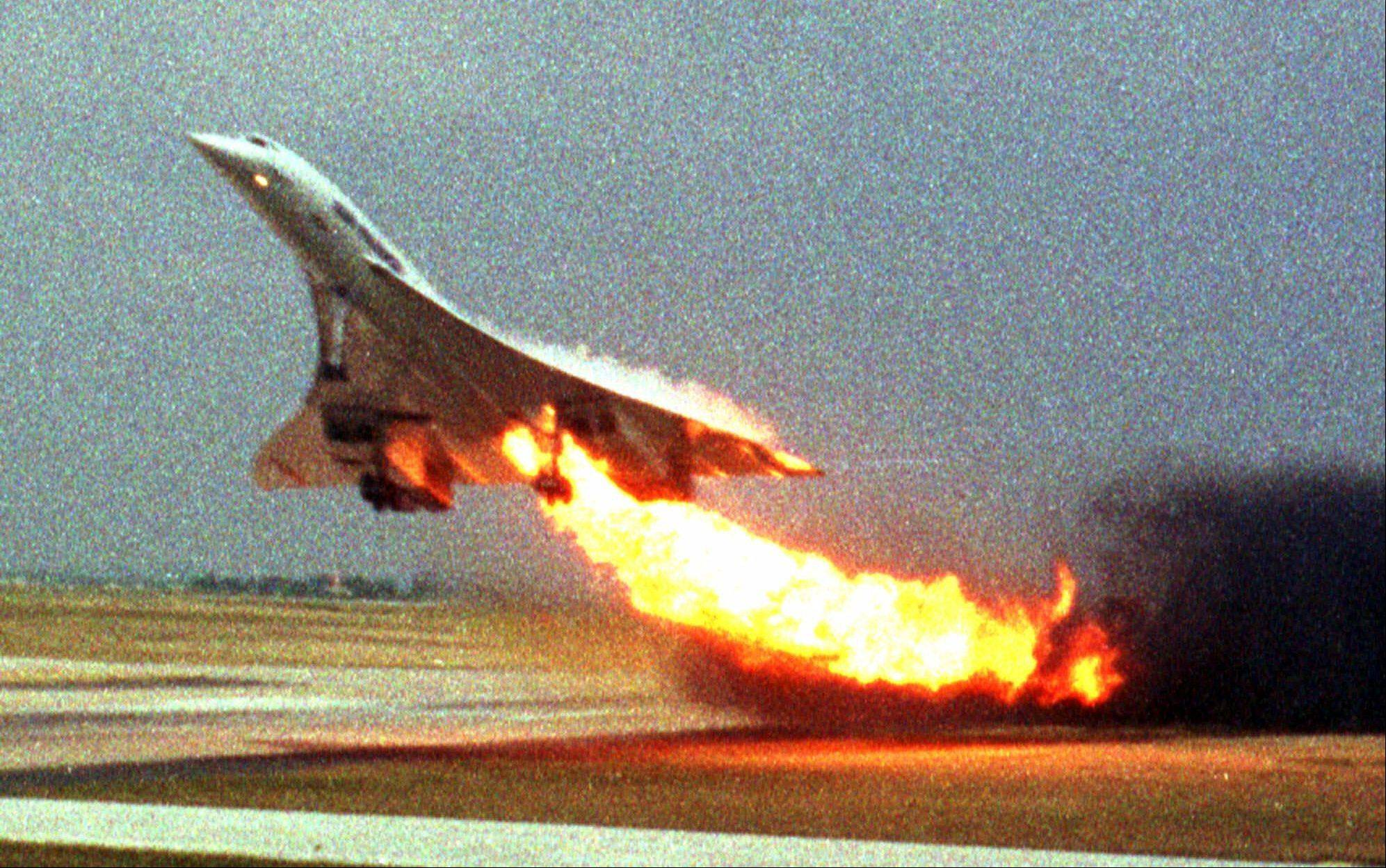 In this July 25, 2000, photo, Air France Concorde flight 4590 takes off with fire trailing from its engine on the left wing from Charles de Gaulle airport in Paris.