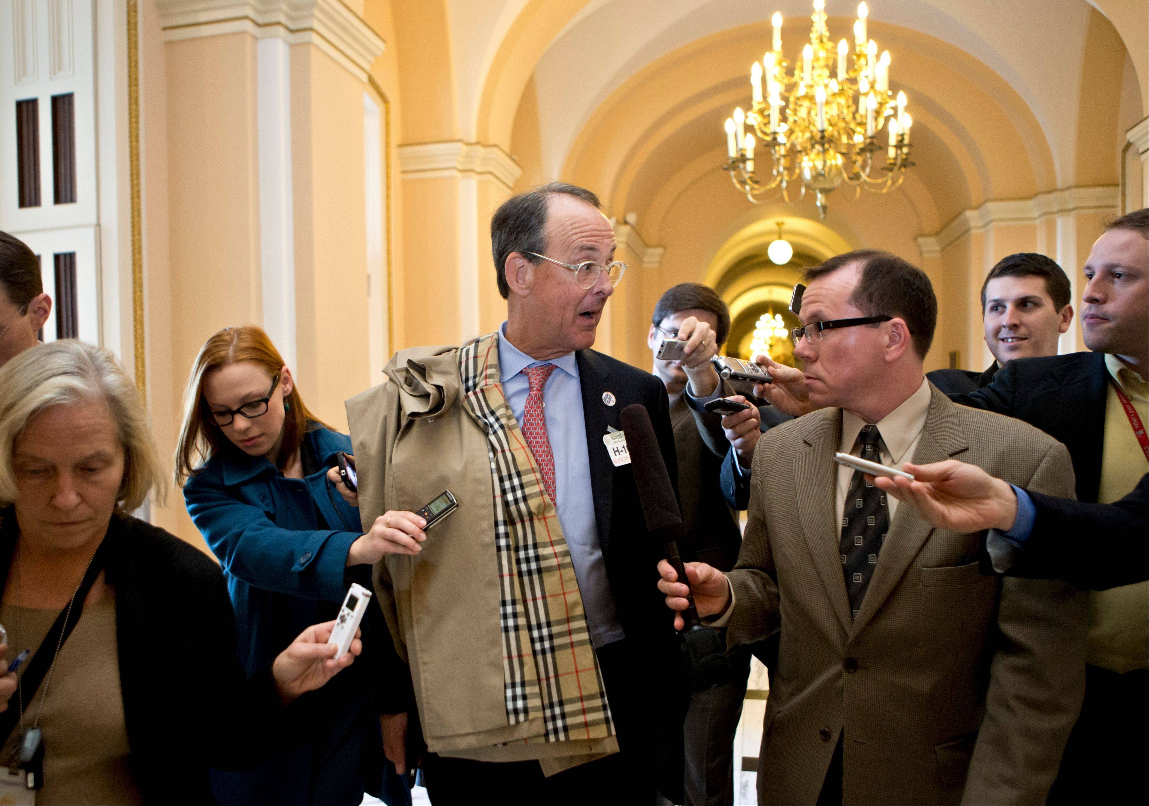 Former White House Chief of Staff Erskine Bowles, co-chair of the National Commission on Fiscal Responsibility and Reform, is pursued by reporters on Capitol Hill in Washington, Wednesday following a closed-door meeting House Speaker John Boehner of Ohio.