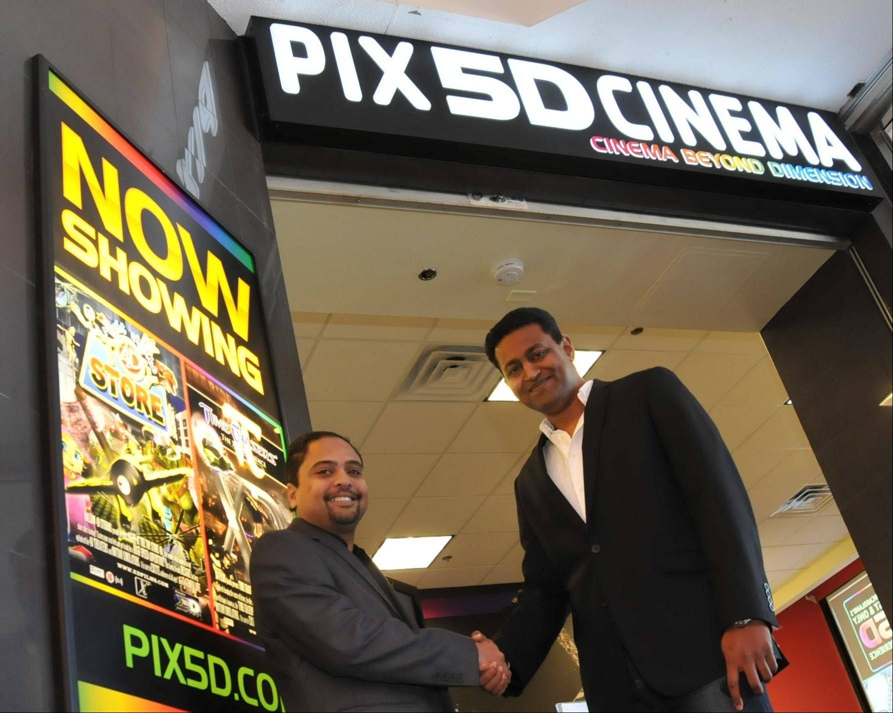 Palatine neighbors Satish Thirumalai, left, and Anand Shanmugan officially open their new enterprise, PIX 5D Cinema, the area's first 5-D theater experience at Woodfield Mall in Schaumburg.