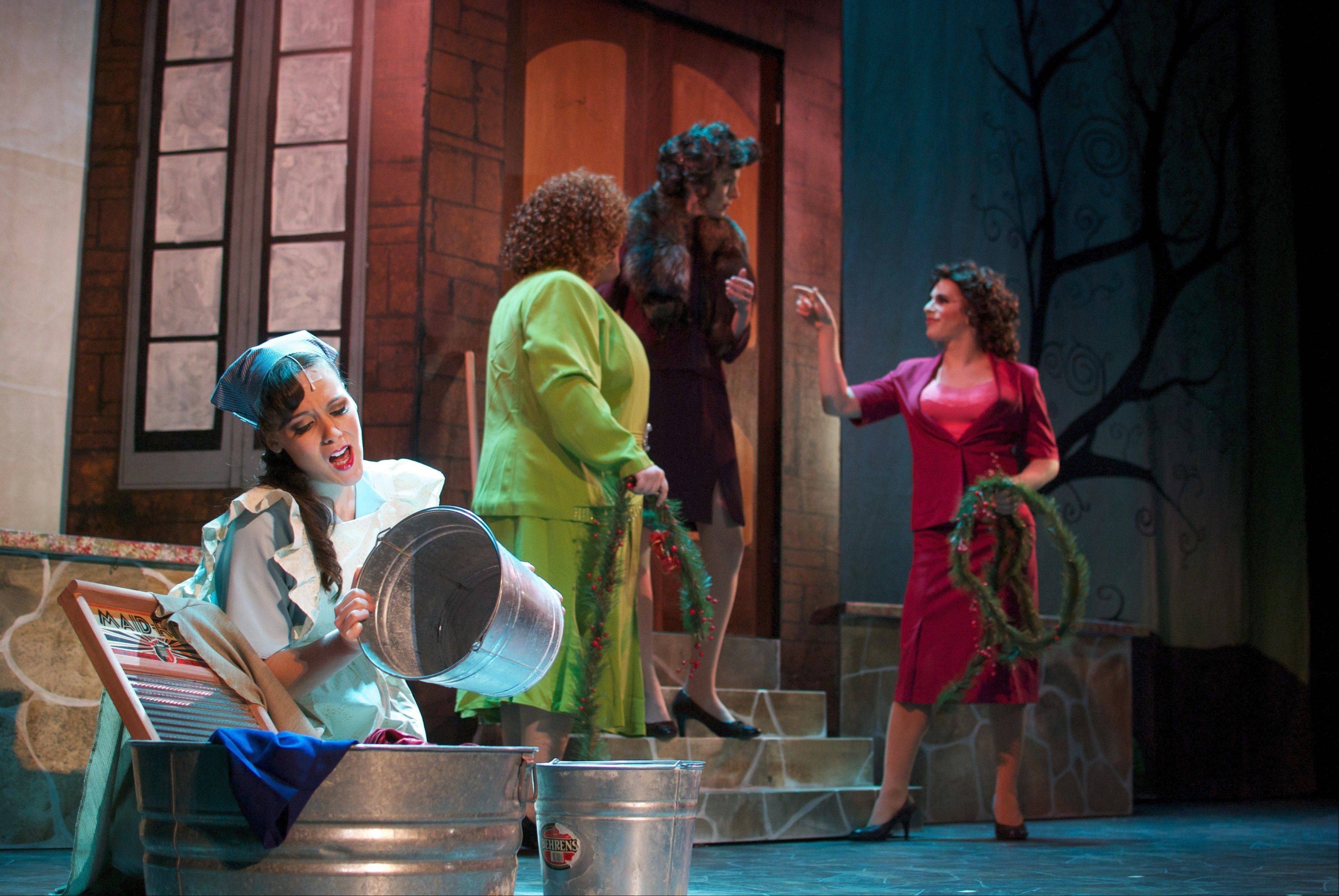 "Cinderella (Missy Karle) washes clothes while her evil family hovers behind her in the Emerald City Theatre's production of ""Cinderella."" The evil family, from left, includes stepsister Grace (Tommy Bullington), stepmother (Heather Townsend) and stepsister Temperance (Mark Kosten)."