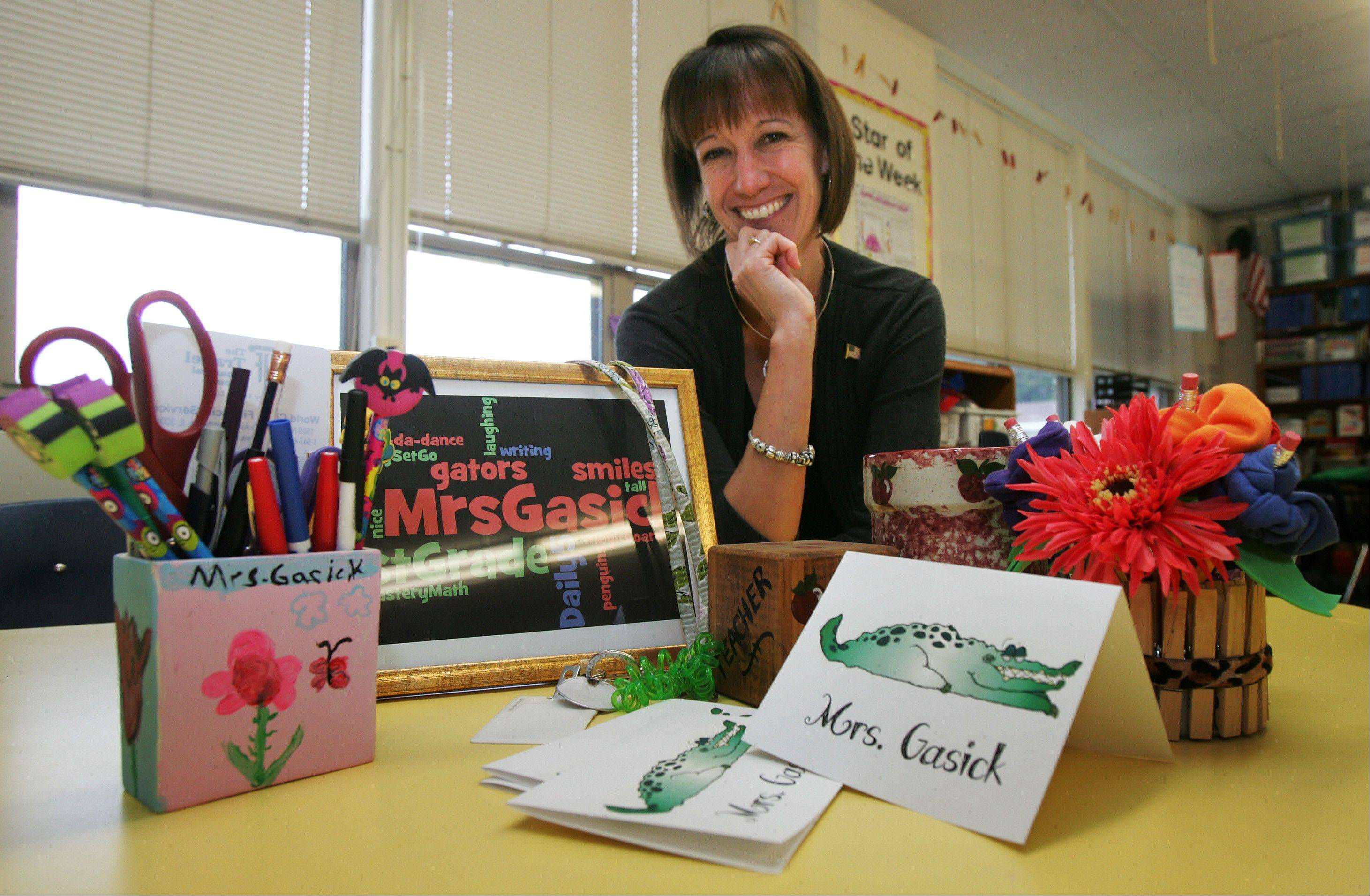 First-grade teacher Theresa Gasick with gifts given to her by students for the holiday season at Adler Park School in Libertyville.