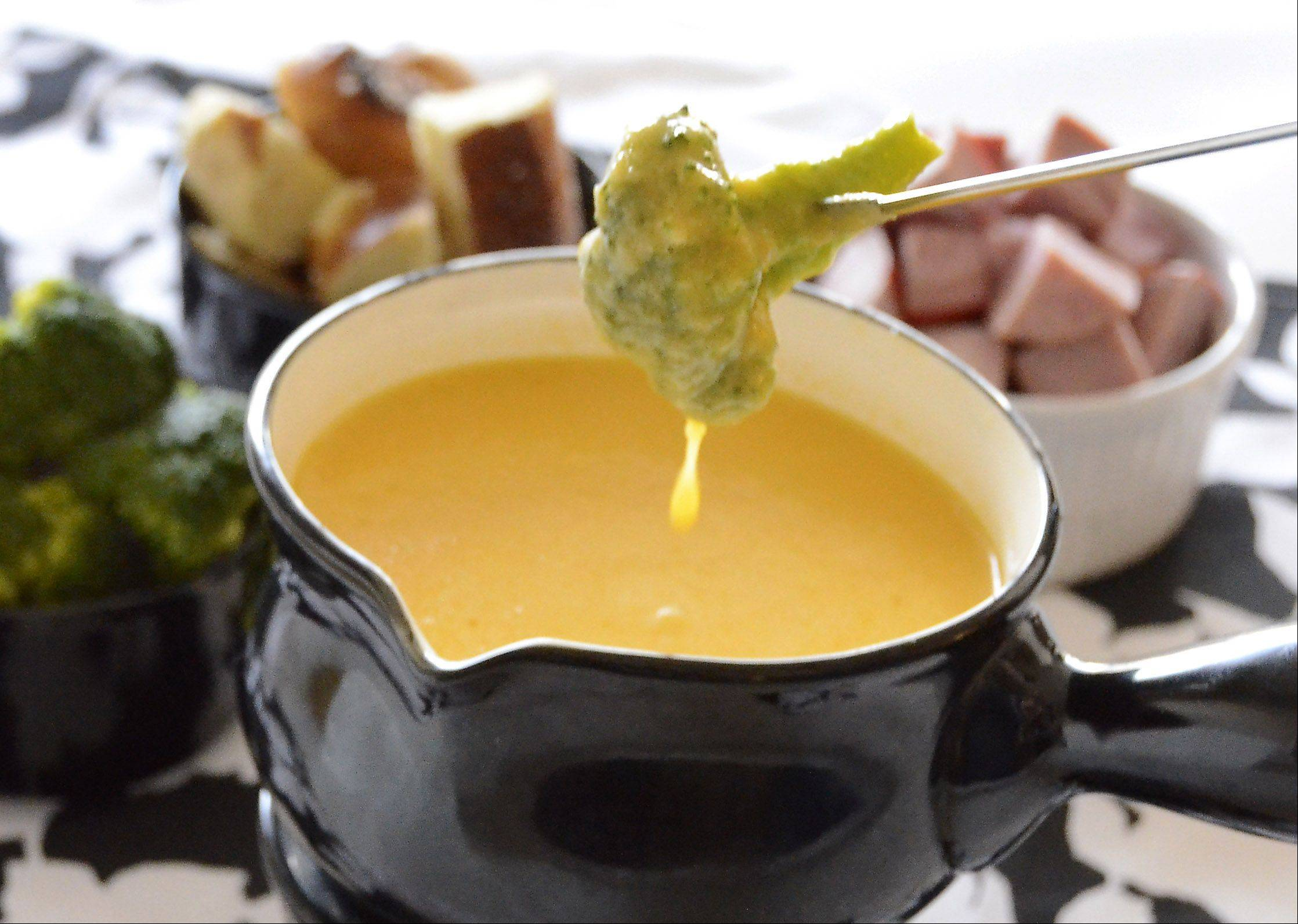 Cheese fondue makes a fun, festive meal that everyone can enjoy.