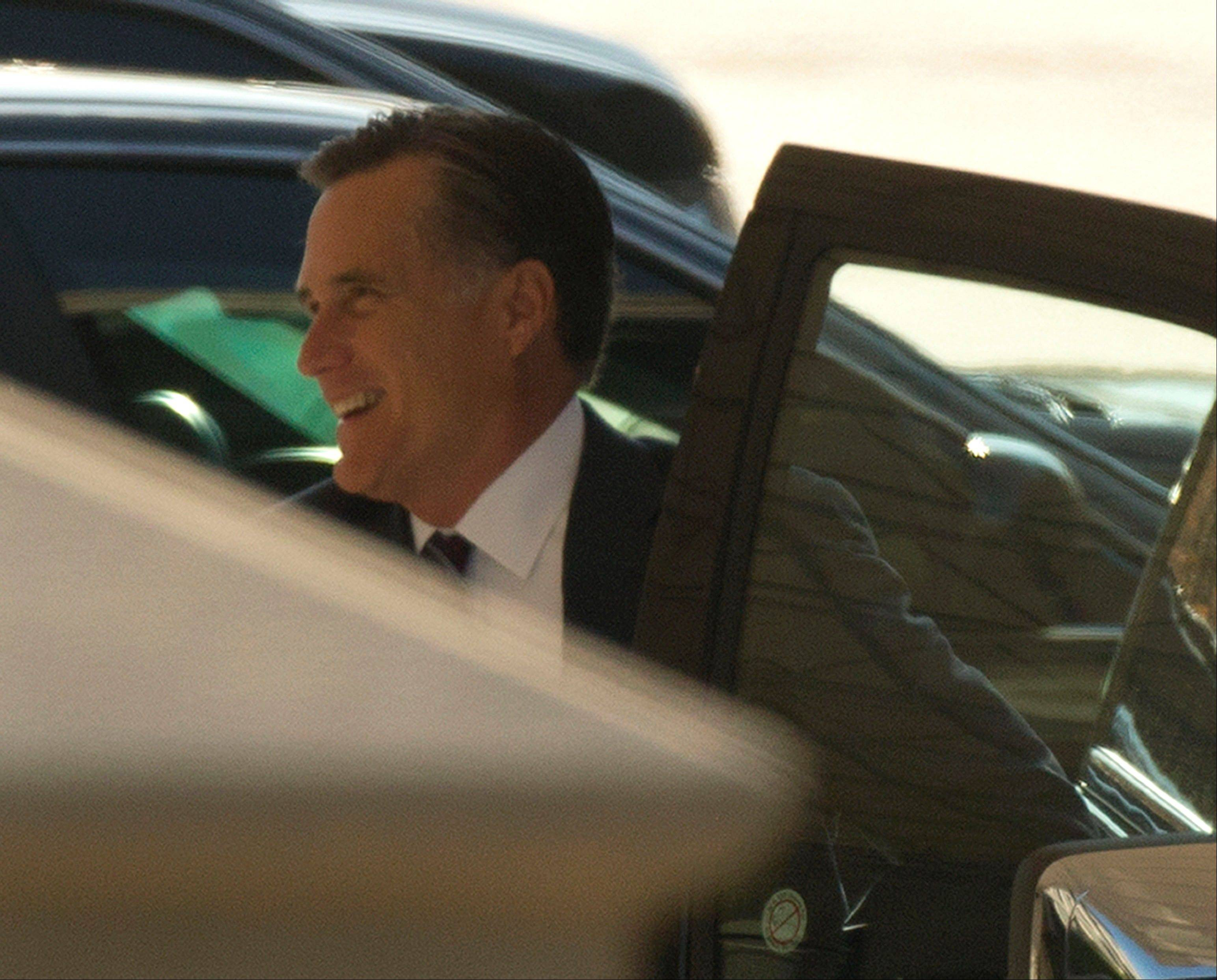 Former Republican presidential candidate Mitt Romney arrives at the White House in Washington, Thursday for his luncheon with President Barack Obama.